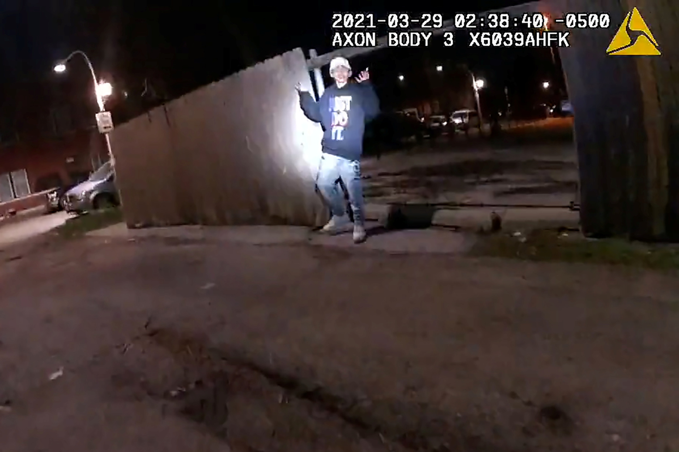 Adam Toledo, 13, holds up his hands a split second before he was shot by police in Little Village, a neighborhood on the West Side of Chicago, Illinois, U.S. March 29, 2021 in a still image from police body camera video. Image taken March 29, 2021.    Civilian Office of Police Accountability/Handout via REUTERS