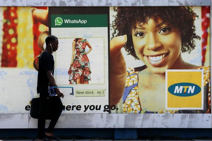 A man walks past an advertising poster for MTN telecommunication company along a street in Lagos, Nigeria, file. REUTERS/Afolabi Sotunde