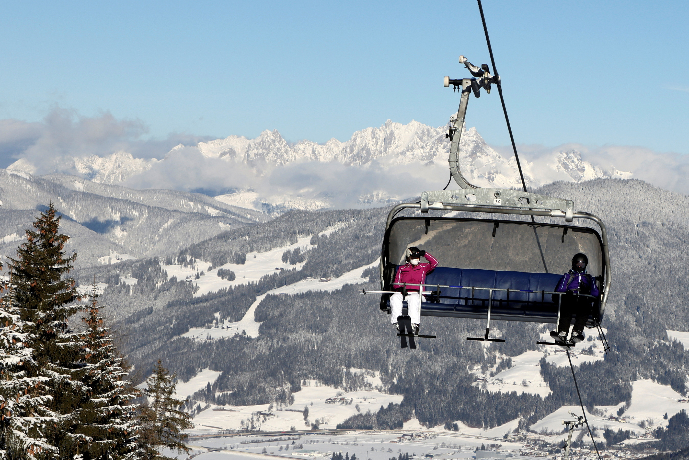 Skiers practise COVID-19 social distancing on a chairlift in Flachau, Austria January 15, 2021. REUTERS/Leonhard Foeger