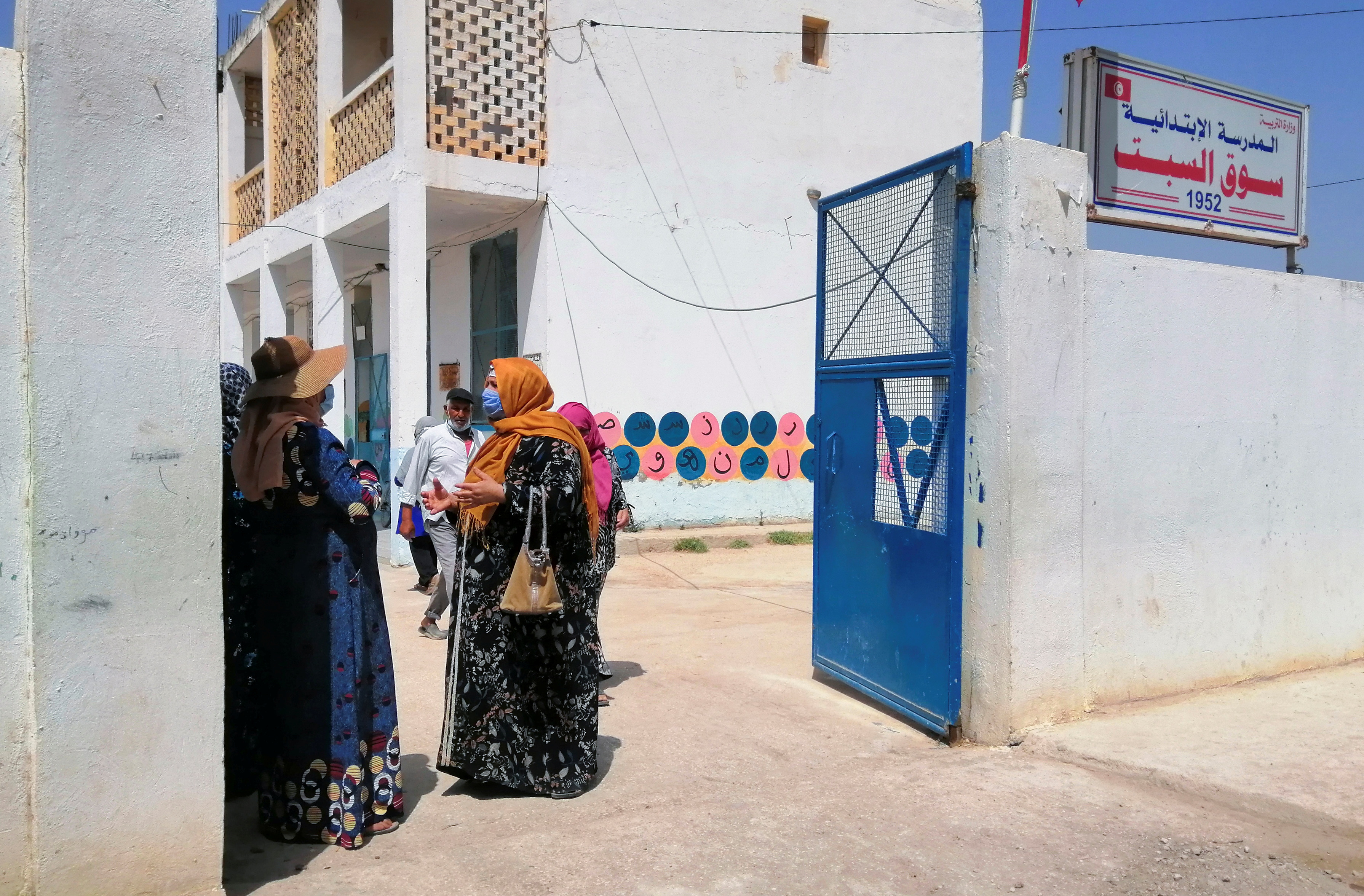 People stand in a school during a vaccination campaign against coronavirus disease (COVID-19) managed by the army, in Jendouba, west of Tunis, Tunisia  July 30, 2021. Picture taken July 30, 2021. REUTERS/Jihed Abidellaoui