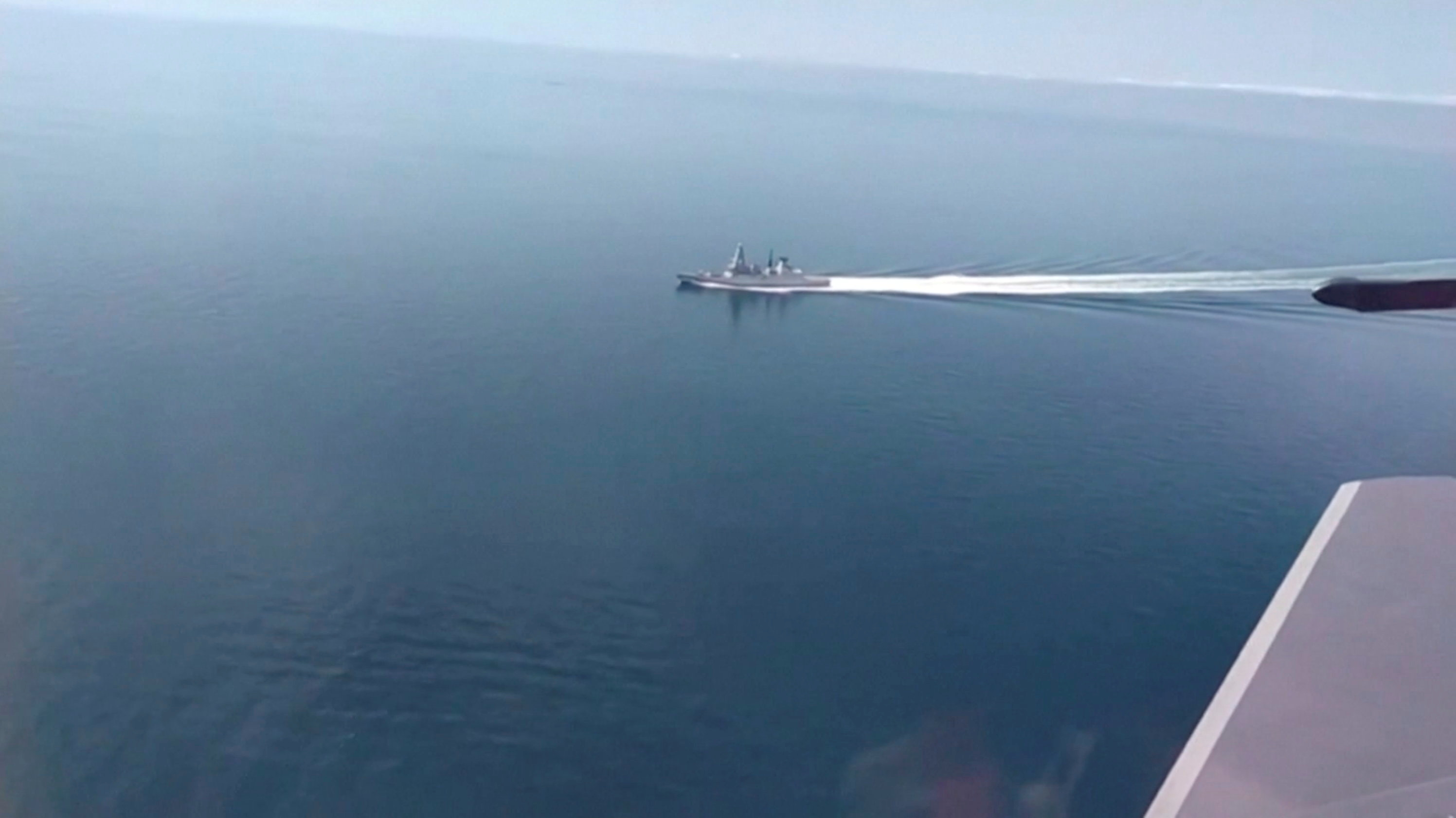 A still image taken from a video released by Russia's Defence Ministry allegedly shows British Royal Navy's Type 45 destroyer HMS Defender filmed from a Russian military aircraft in the Black Sea, June 23, 2021. Ministry of Defence of the Russian Federation/Handout via REUTERS