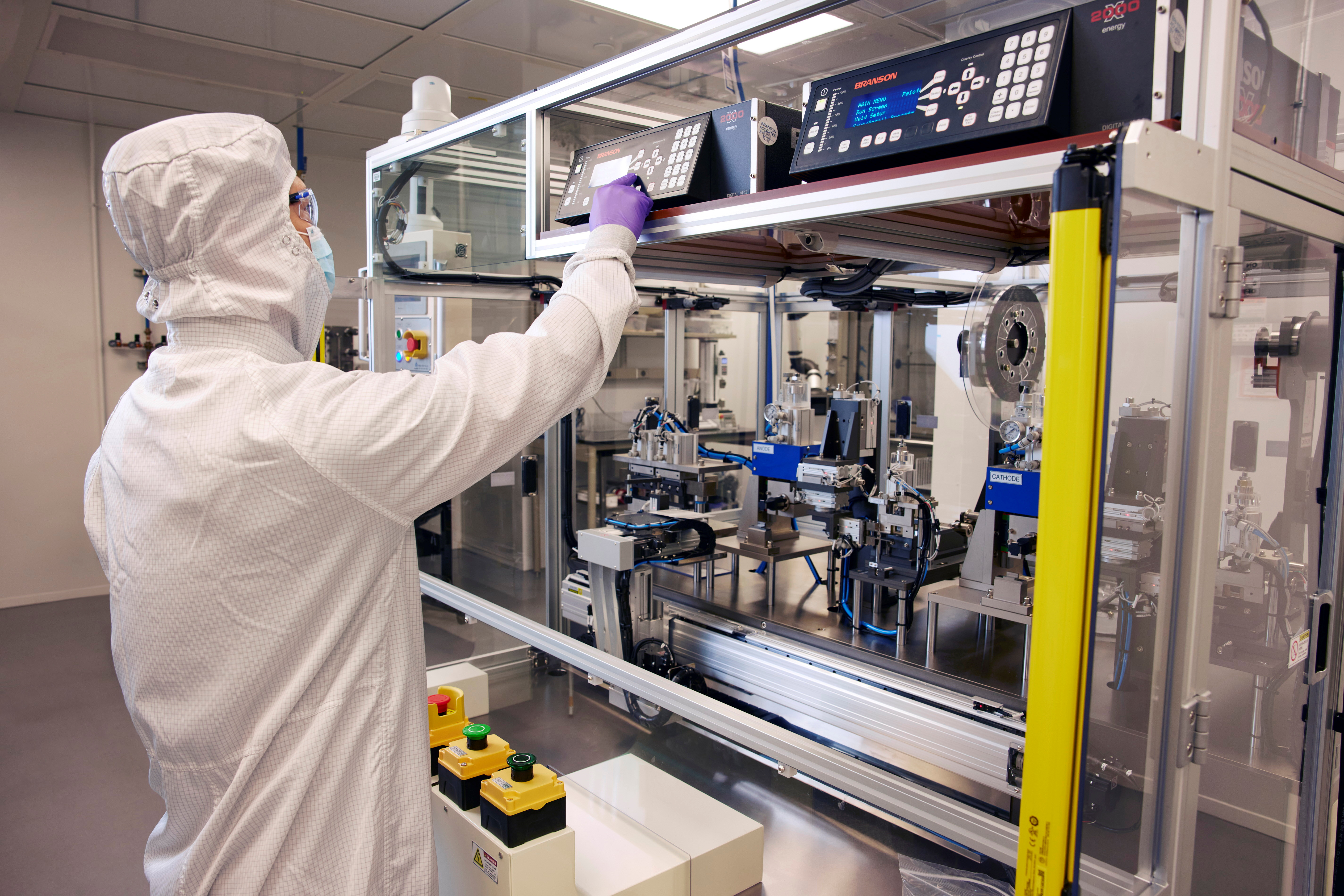 A GM Research and Development electrochemist forms a prototype battery cell in the fabrication lab within GM's Global Technical Center in Warren, Michigan, U.S., in an undated photograph. General Motors/Handout via REUTERS
