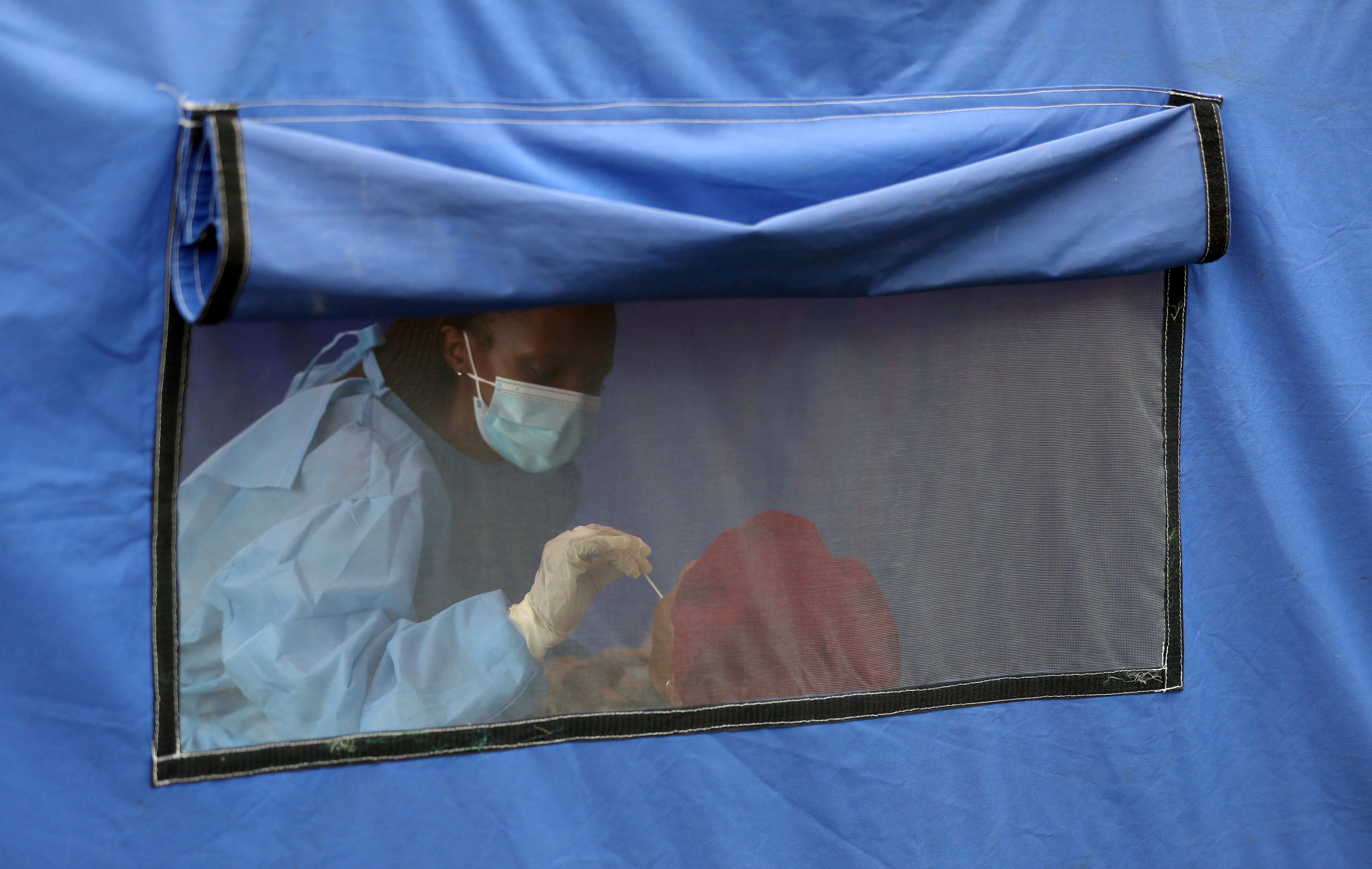 A traveller is tested for the coronavirus disease amid a nationwide COVID-19 lockdown, at the Grasmere Toll Plaza, in Lenasia, South Africa, January 14, 2021. REUTERS/Siphiwe Sibeko