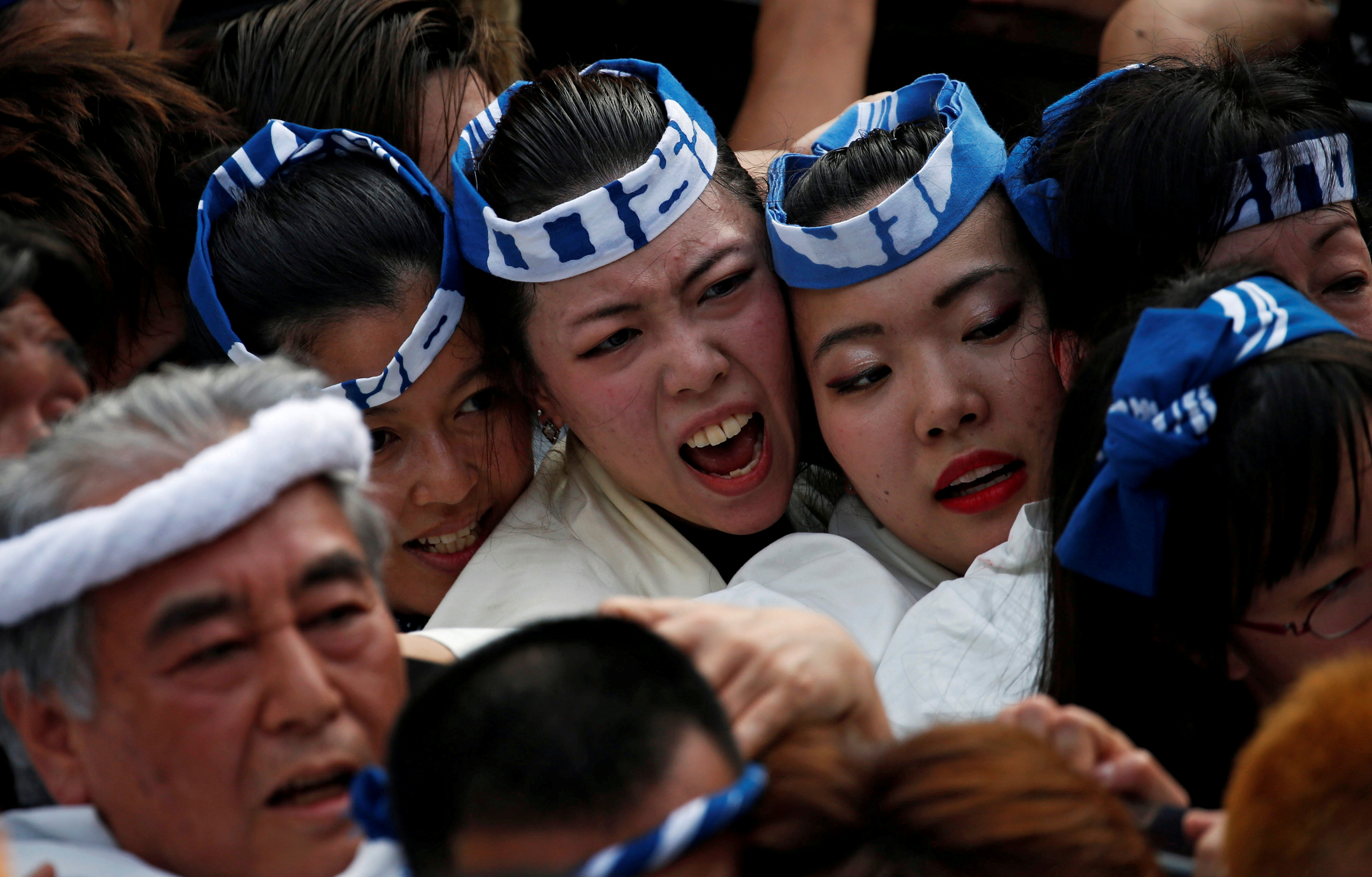 Shrine parishioners carry a portable shrine into the Kanda Myojin Shrine during the Kanda festival, one of the three major Shinto festivals in Tokyo, Japan, May 14, 2017.   REUTERS/Toru Hanai/File Photo