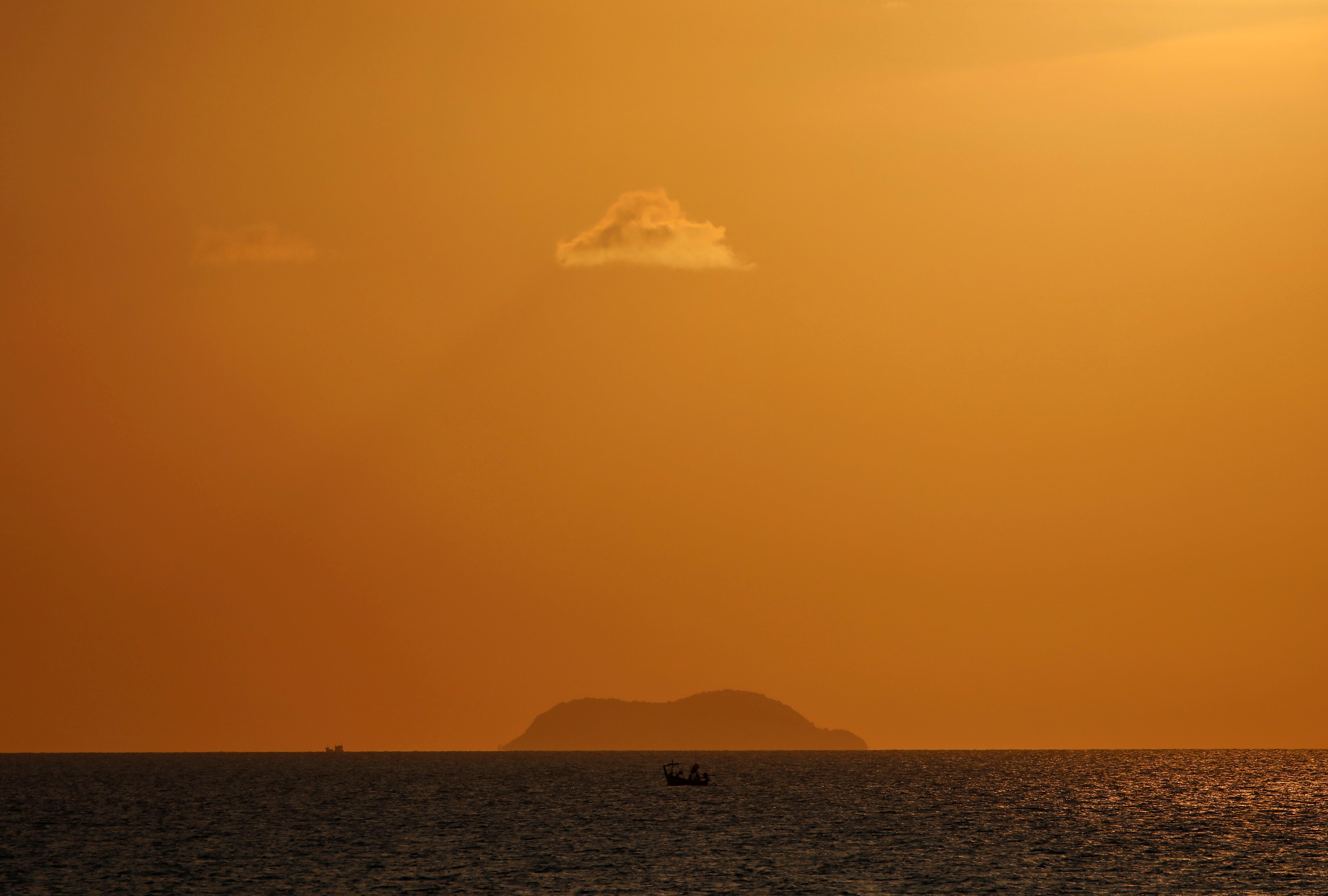 A boat sails on the Gulf of Thailand during the sunset at Ko Samui in Thailand March 3, 2020. REUTERS/Navesh Chitrakar/File Photo