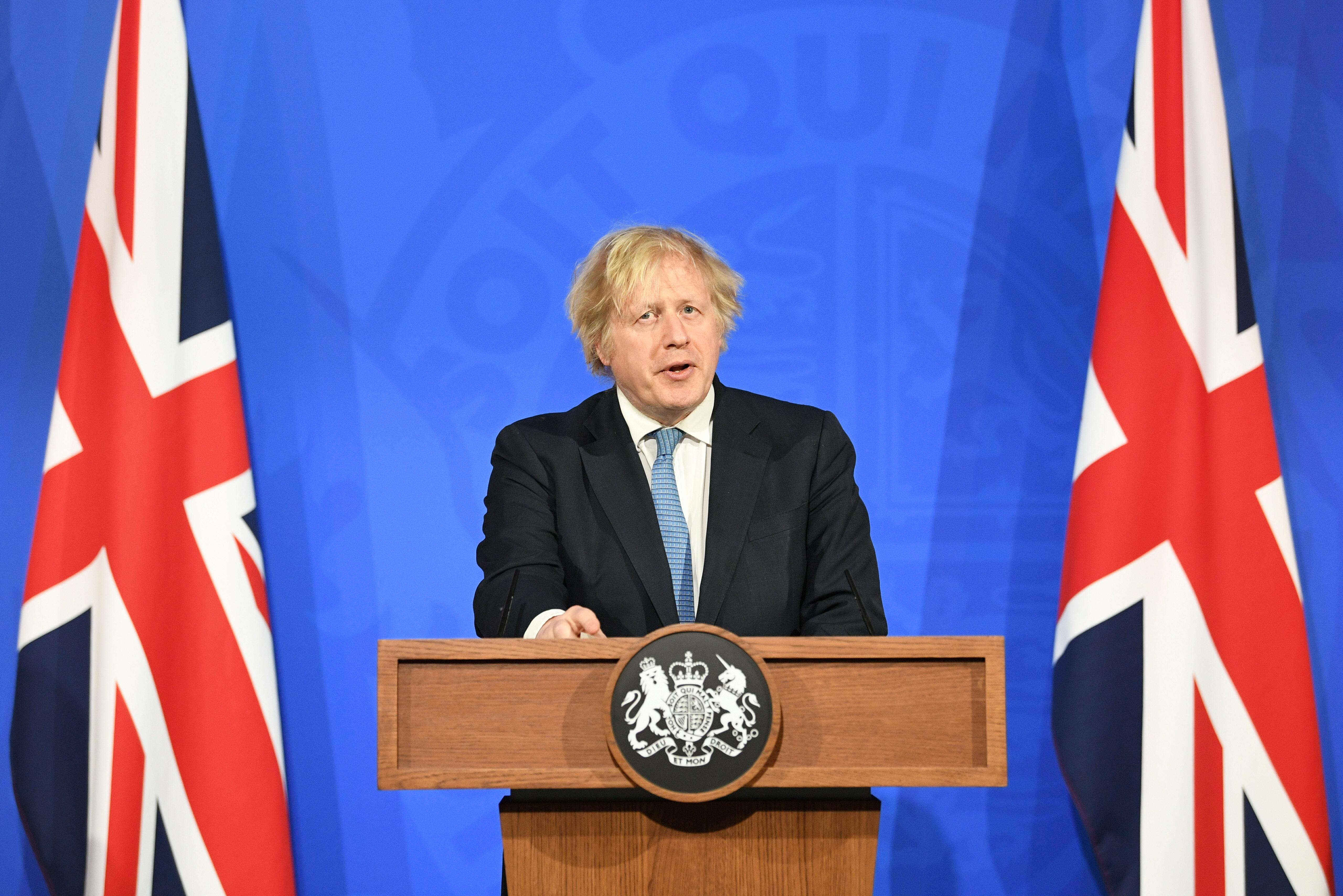 Britain's Prime Minister Boris Johnson holds a news conference on the coronavirus disease (COVID-19) pandemic, in London, Britain April 5, 2021. Stefan Rousseau/Pool via REUTERS
