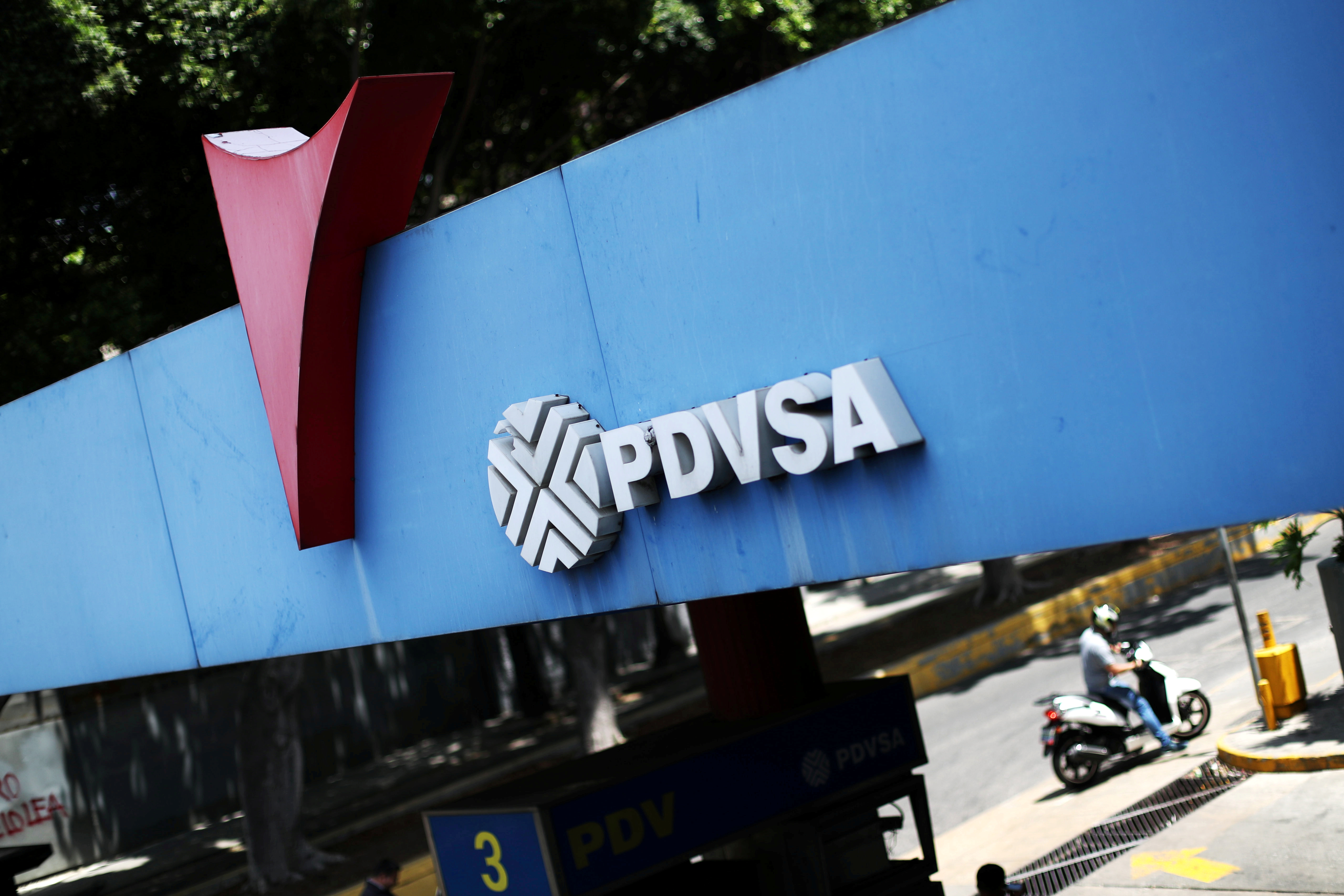 A state oil company PDVSA's logo is seen at a gas station in Caracas, Venezuela May 17, 2019. REUTERS/Ivan Alvarado/File Photo