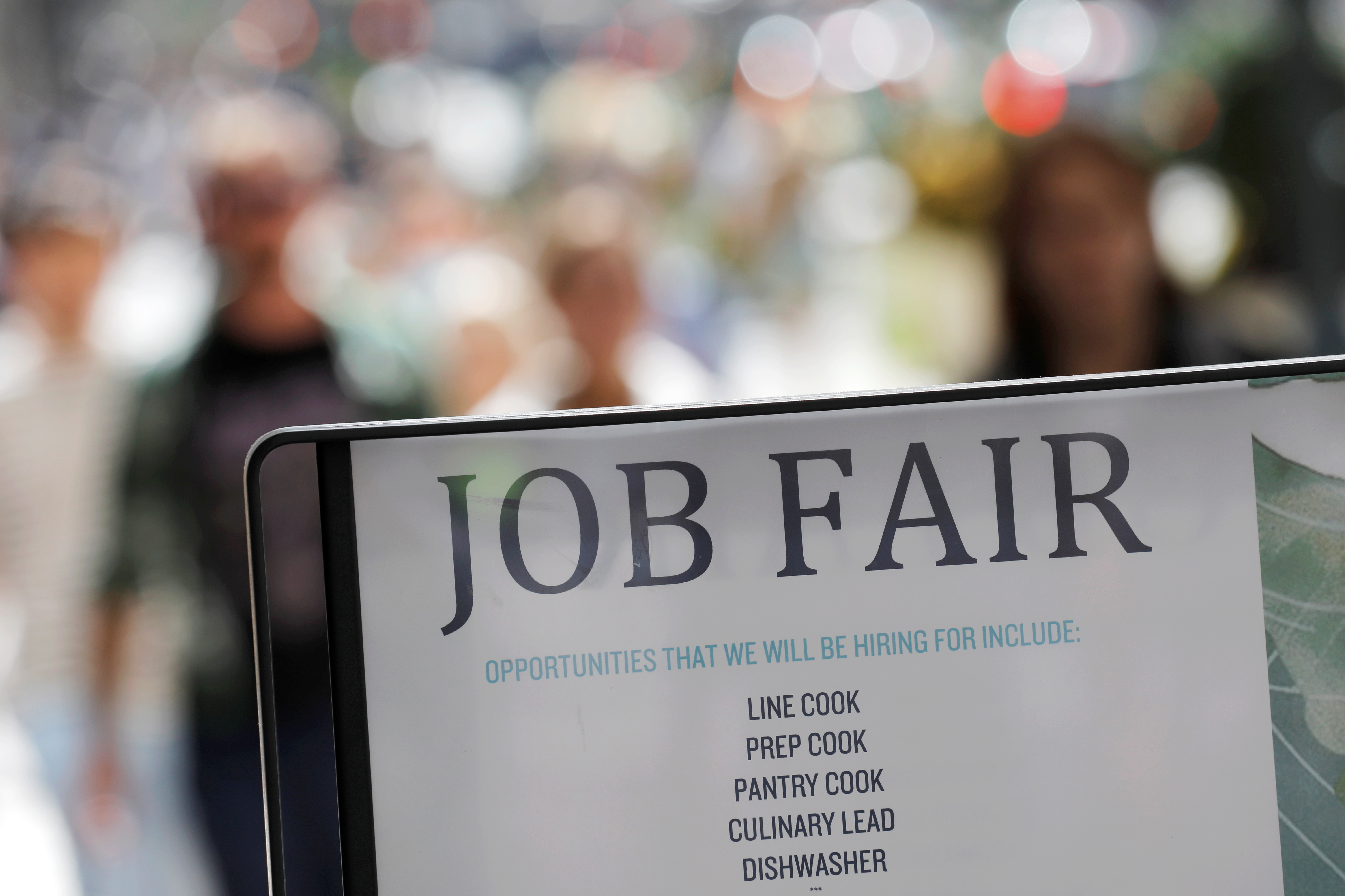 Signage for a job fair is seen on 5th Avenue after the release of the jobs report in Manhattan, New York City, U.S., September 3, 2021. REUTERS/Andrew Kelly