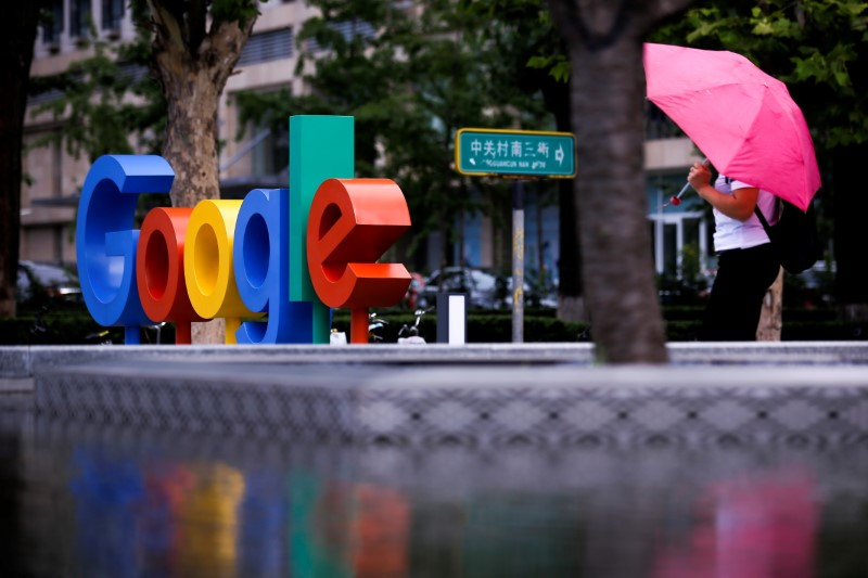 The brand logo of Alphabet Inc's Google is seen outside its office in Beijing, China, August 8, 2018.  REUTERS/Thomas Peter/File Photo