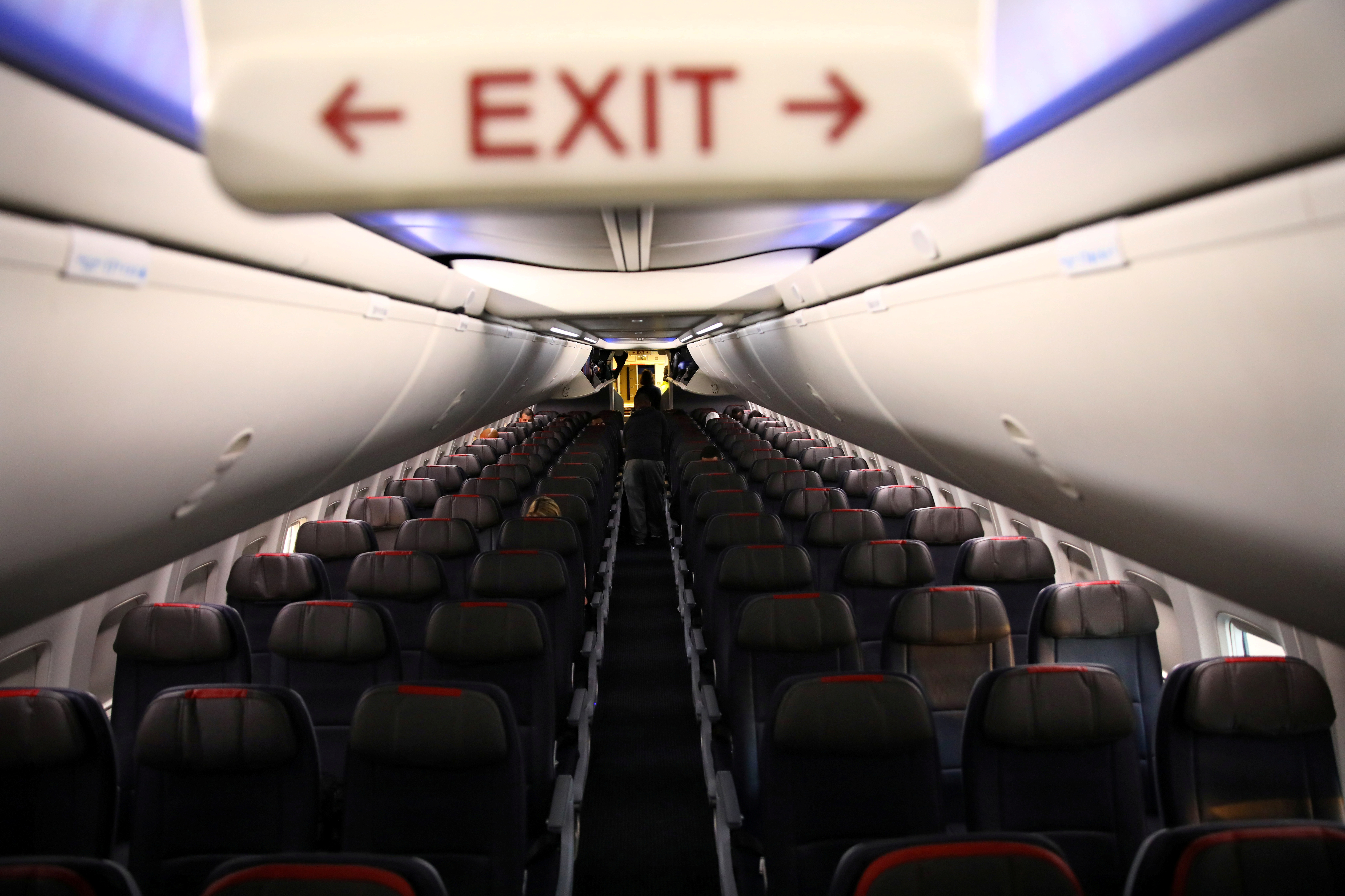 Rows of empty seats of an American Airline flight are seen, as coronavirus disease (COVID-19) disruption continues across the global industry, during a flight between Washington D.C. and Miami, in Washington, U.S., March 18, 2020. REUTERS/Carlos Barria/File Photo