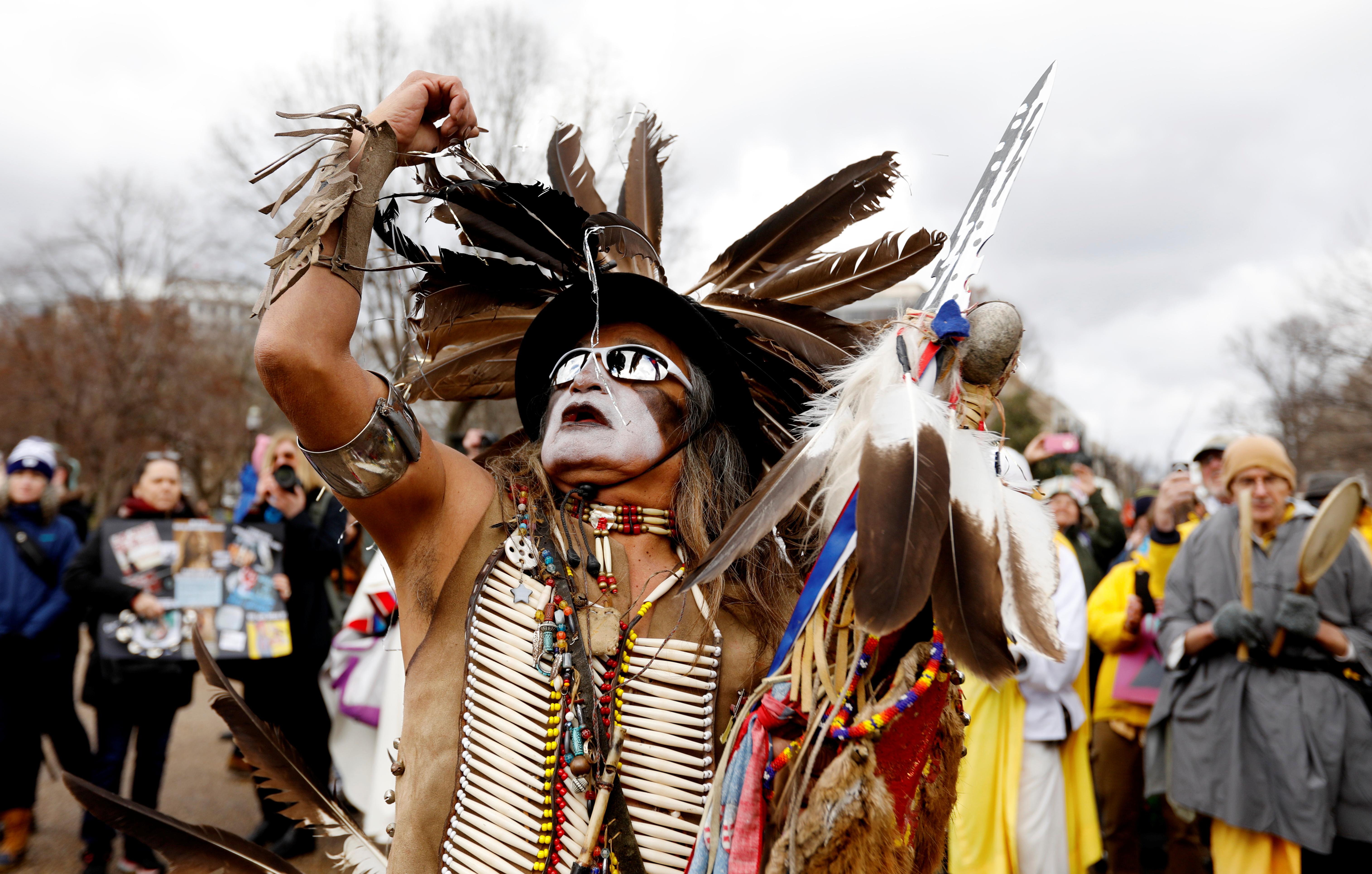 Little Thunder, a traditional dancer and indigenous activist from the Lakota tribe,  during a protest march in opposition to the Dakota Access and Keystone XL pipelines. REUTERS/Kevin Lamarque