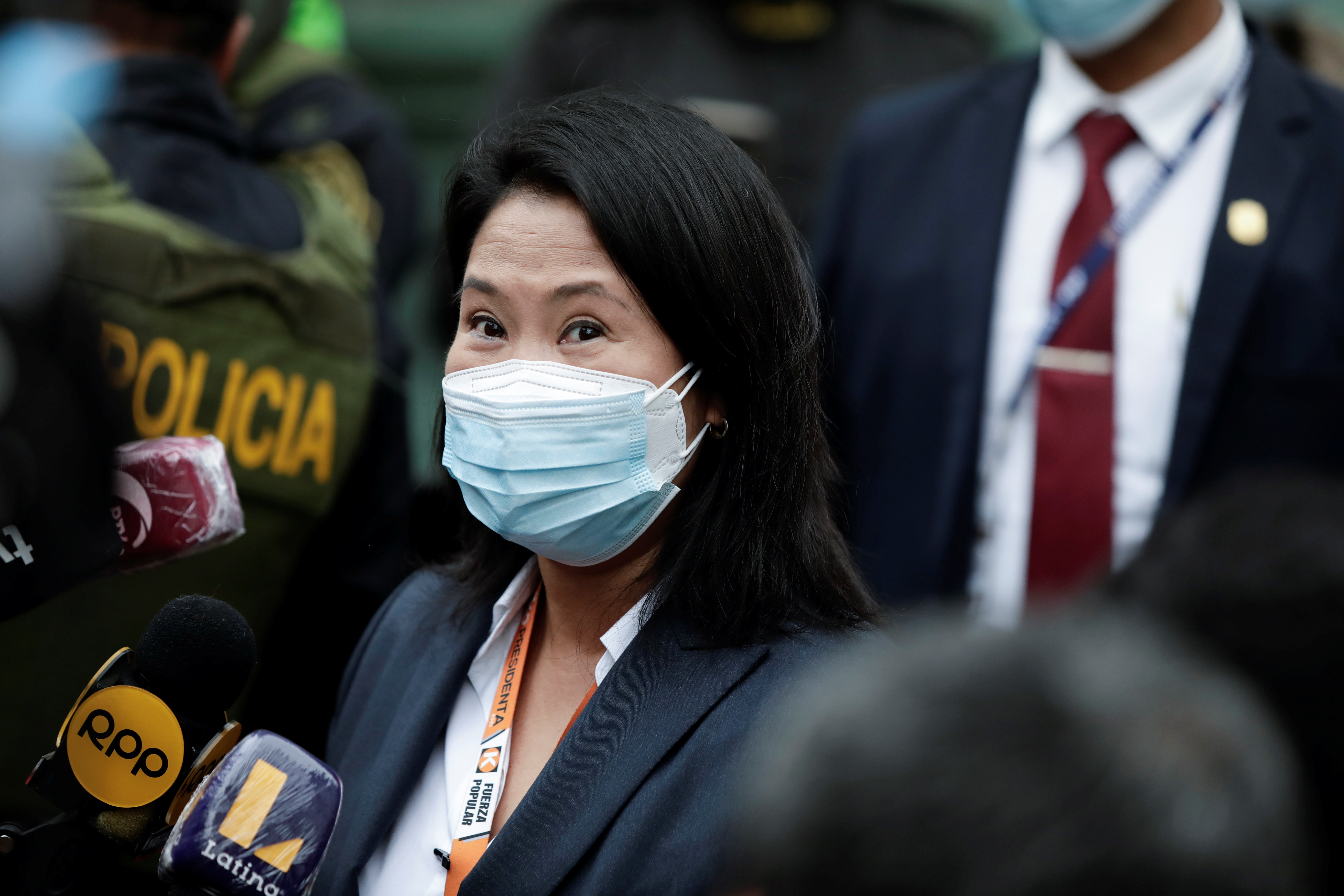 Peru's presidential candidate Keiko Fujimori talks with journalists as she arrives at the National Court of Tacna Avenue in Lima, Peru, June 21, 2021. REUTERS/Angela Ponce