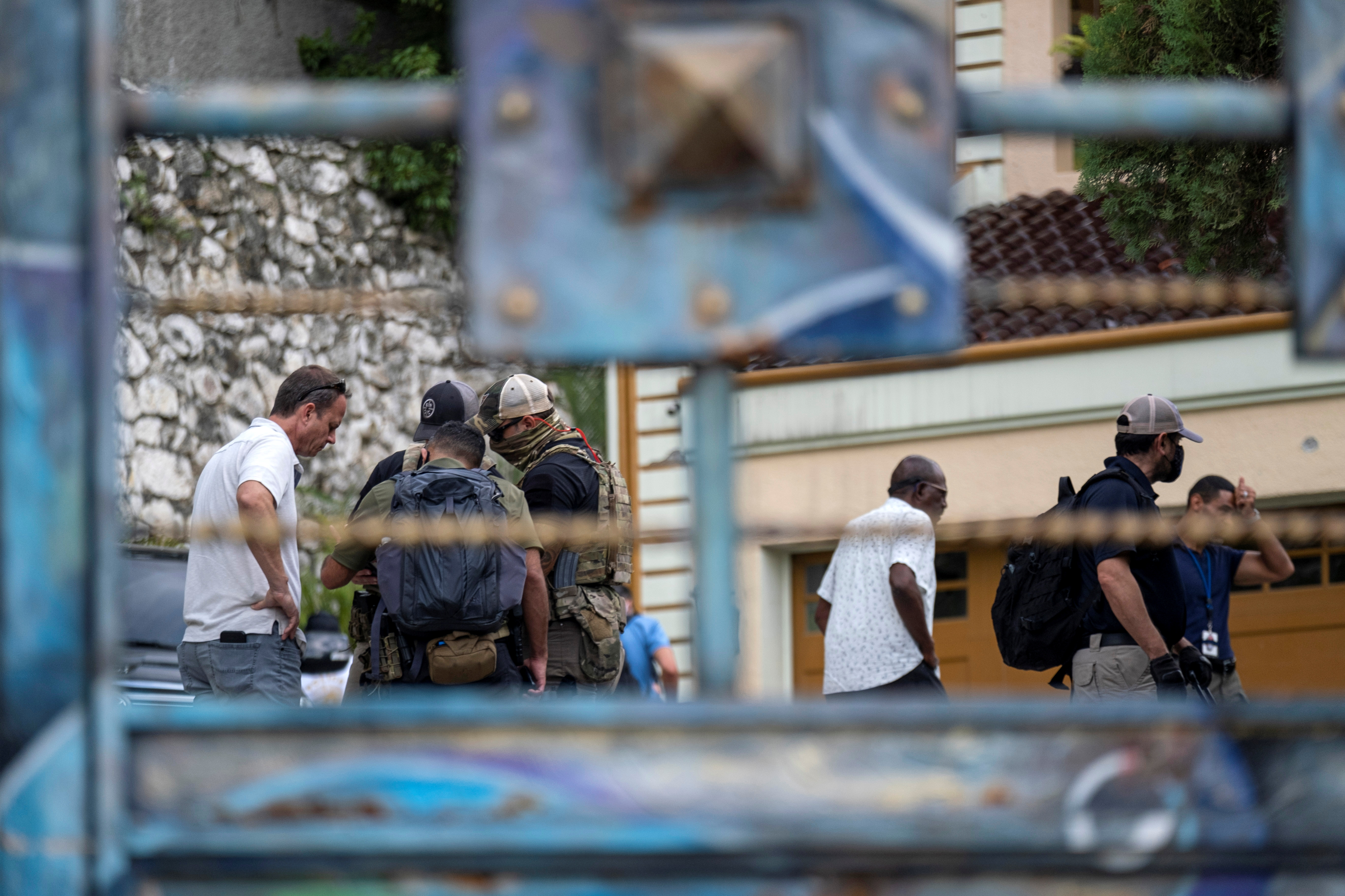FBI agents assisting in the investigation of the assassination of Haiti's President Jovenel Moise inspect his residence in Port-au-Prince, Haiti, July 15, 2021. REUTERS/Ricardo Arduengo