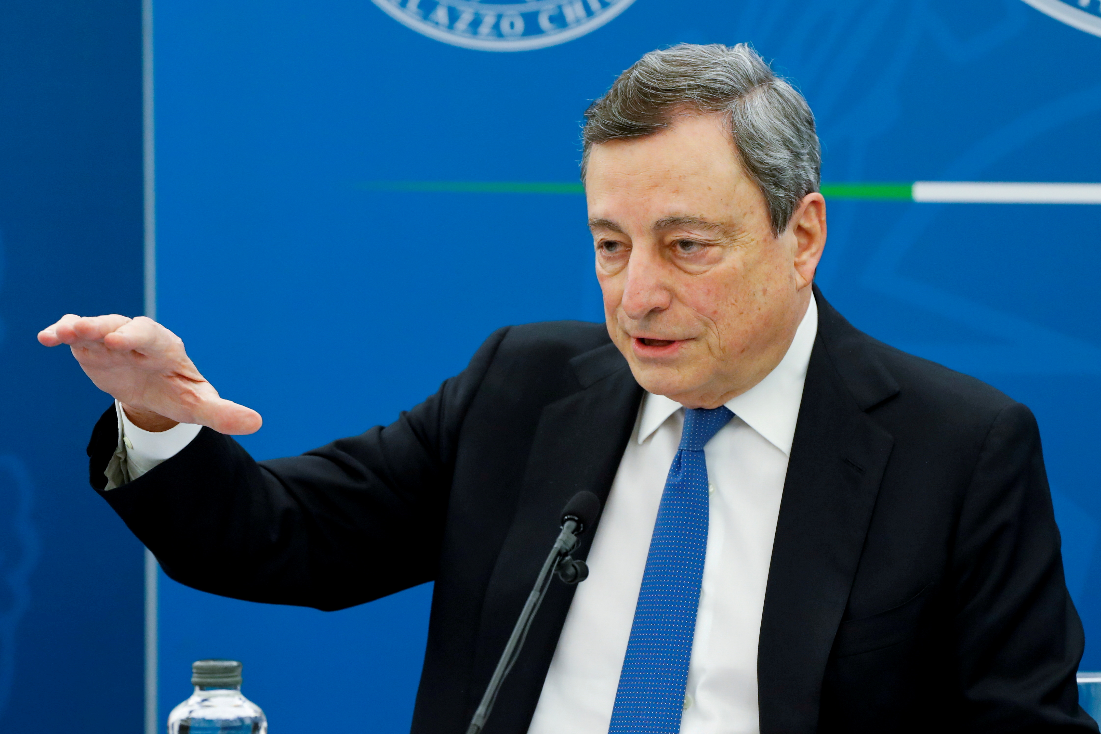 Italy's Prime Minister Mario Draghi gestures as he speaks at a news conference where he is expected to map out the country's next moves in loosening coronavirus disease (COVID-19) restrictions, in Rome, Italy, April 16, 2021. REUTERS/Remo Casilli/File Photo