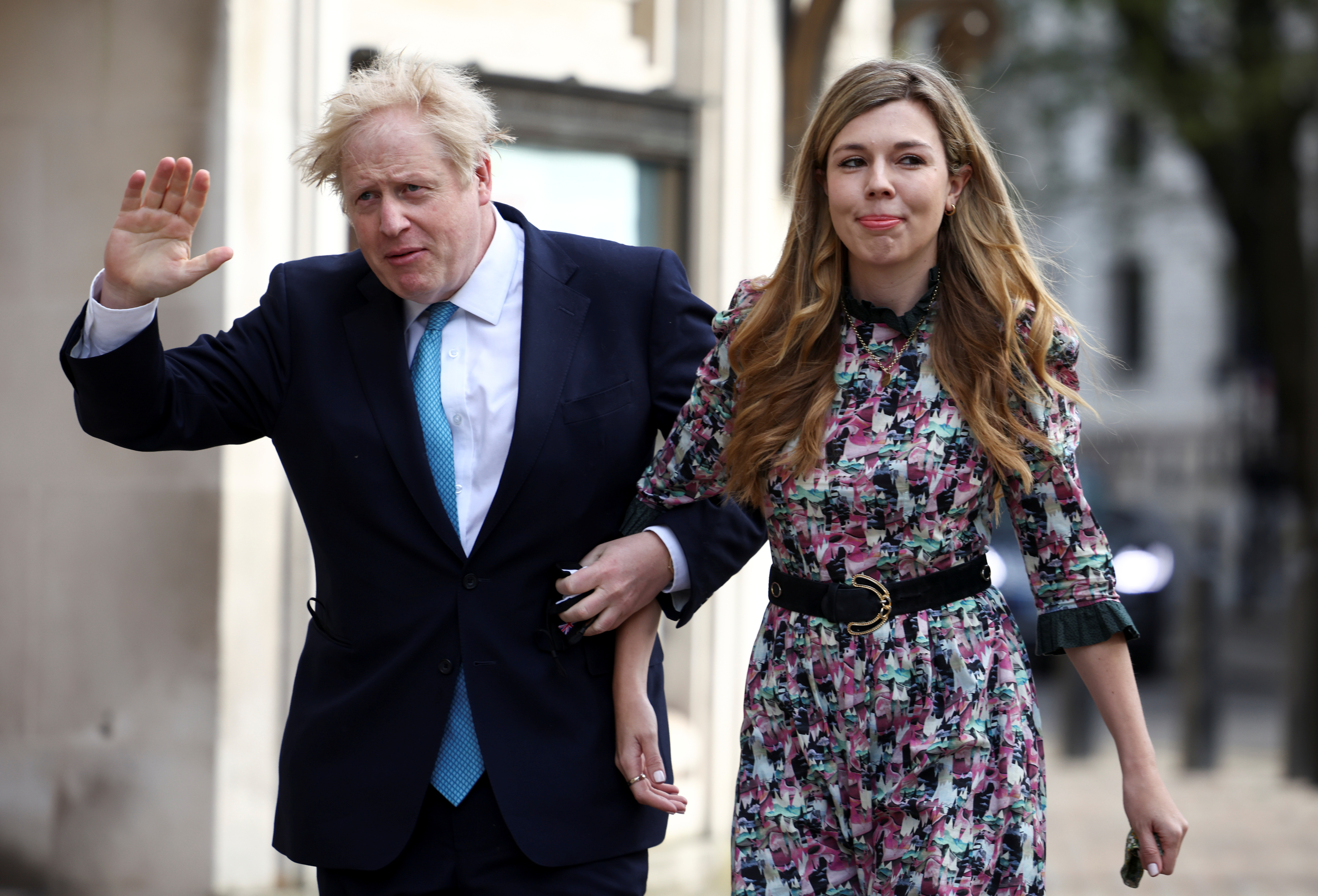 Britain's Prime Minister Boris Johnson and partner Carrie Symonds arrive at a Westminster polling station to vote, in London, Britain May 6, 2021. REUTERS/Henry Nicholls/Files