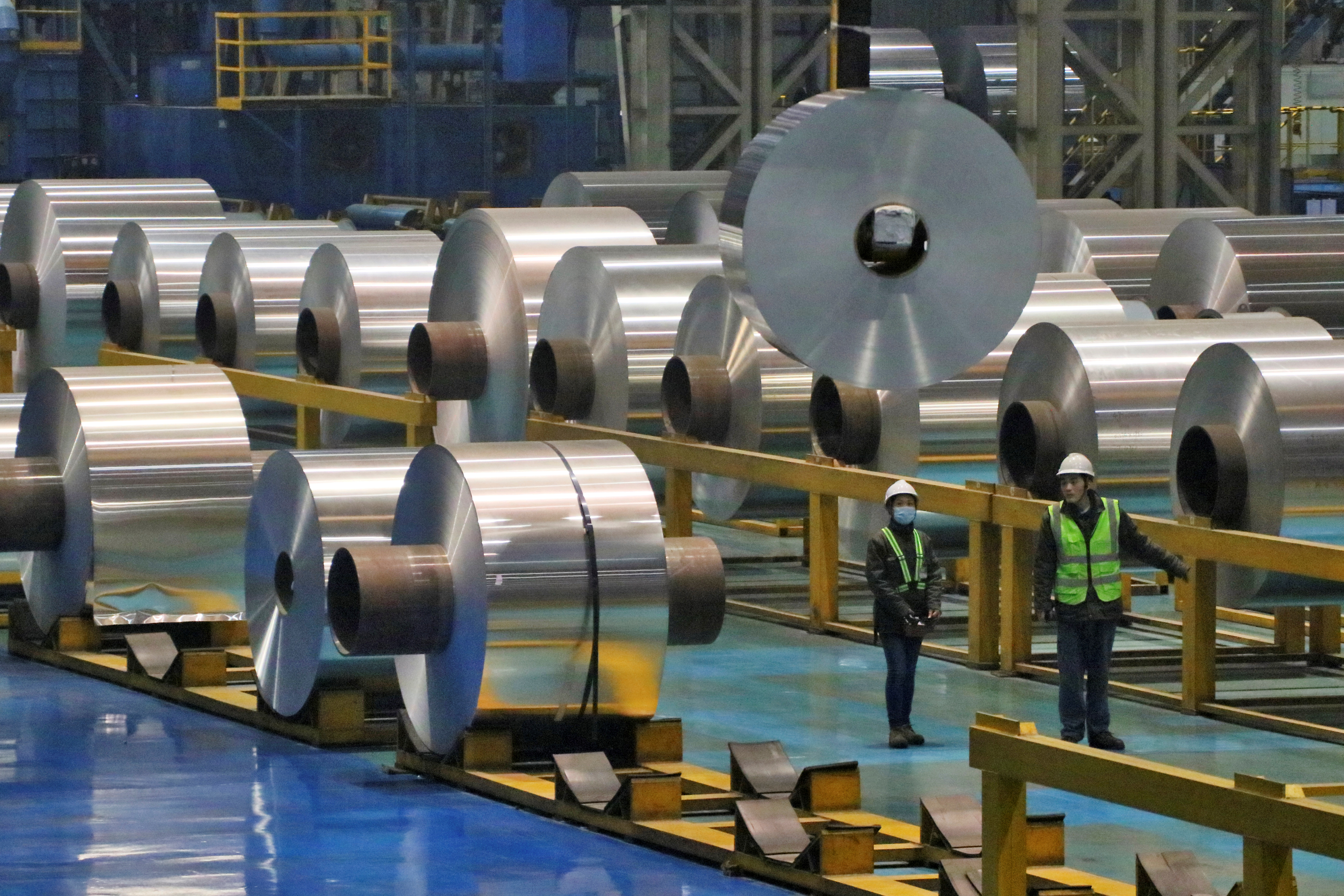 Employees work at the production line of aluminium rolls at a factory in Zouping, Shandong province, China November 23, 2019. REUTERS/Stringer