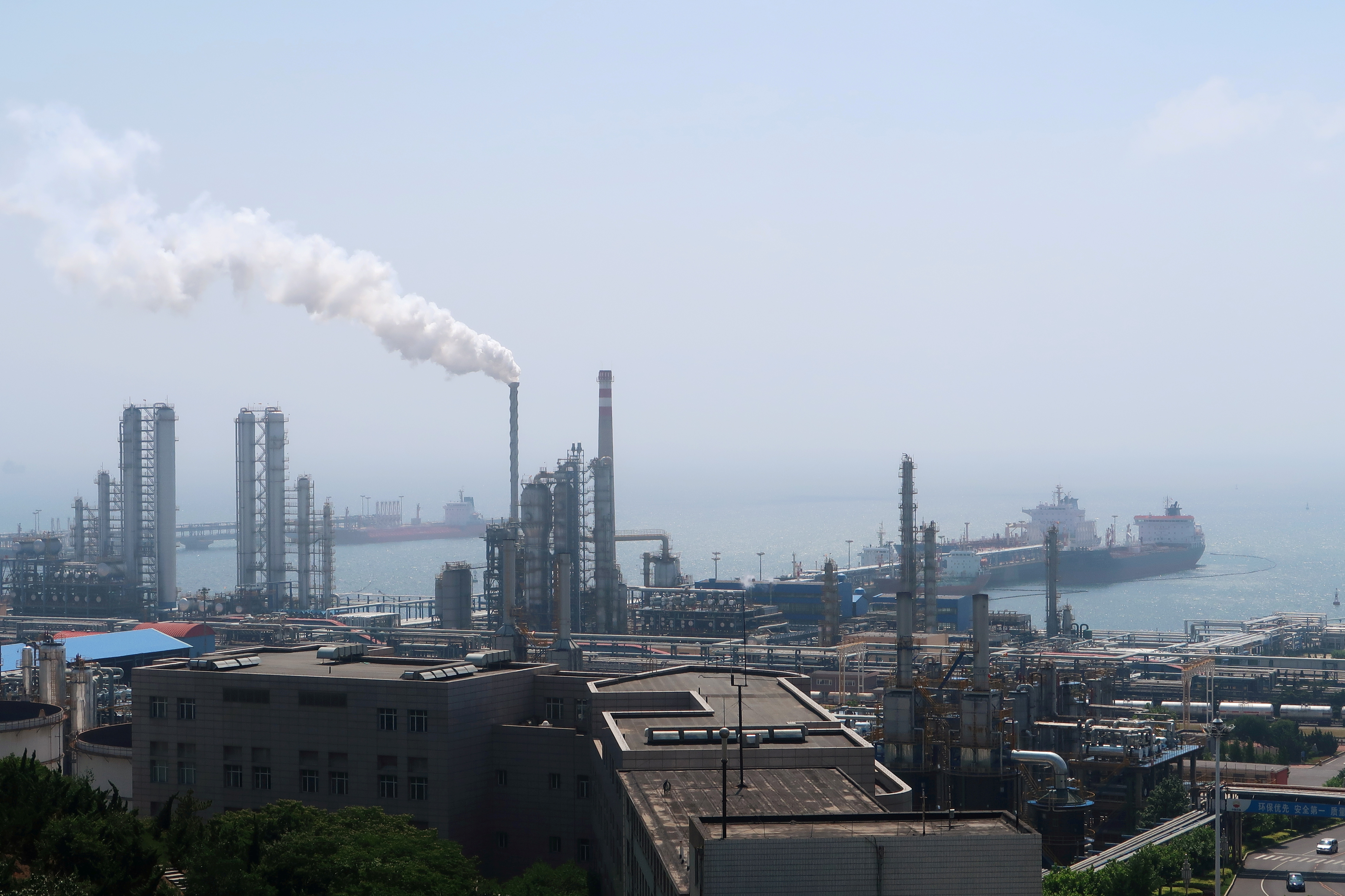 China National Petroleum Corporation (CNPC)'s Dalian Petrochemical Corp refinery is seen near the downtown of Dalian in Liaoning province, China July 17, 2018. Picture taken July 17, 2018. REUTERS/Chen Aizhu/File Photo