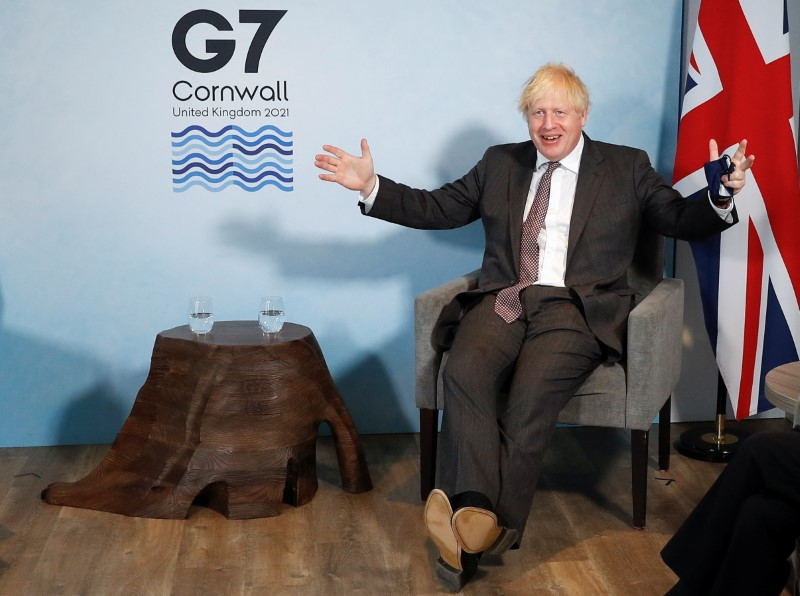 Britain's Prime Minister Boris Johnson reacts as he meets with European Commission President Ursula von der Leyen and European Council President Charles Michel during the G7 summit in Carbis Bay, Cornwall, Britain, June 12, 2021. REUTERS/Peter Nicholls/Pool