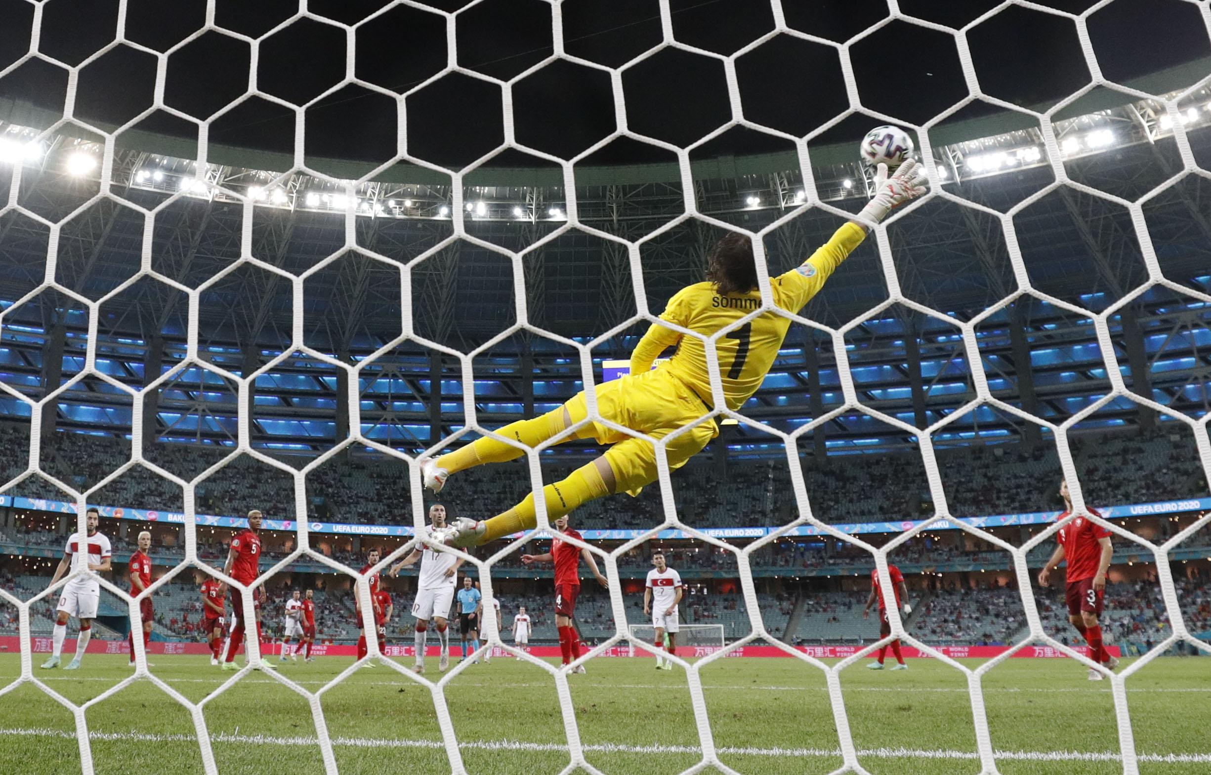 Soccer Football - Euro 2020 - Group A - Switzerland v Turkey - Baku Olympic Stadium, Baku, Azerbaijan - June 20, 2021 Turkey's Irfan Kahveci scores their first goal REUTERS/Valentyn Ogirenko