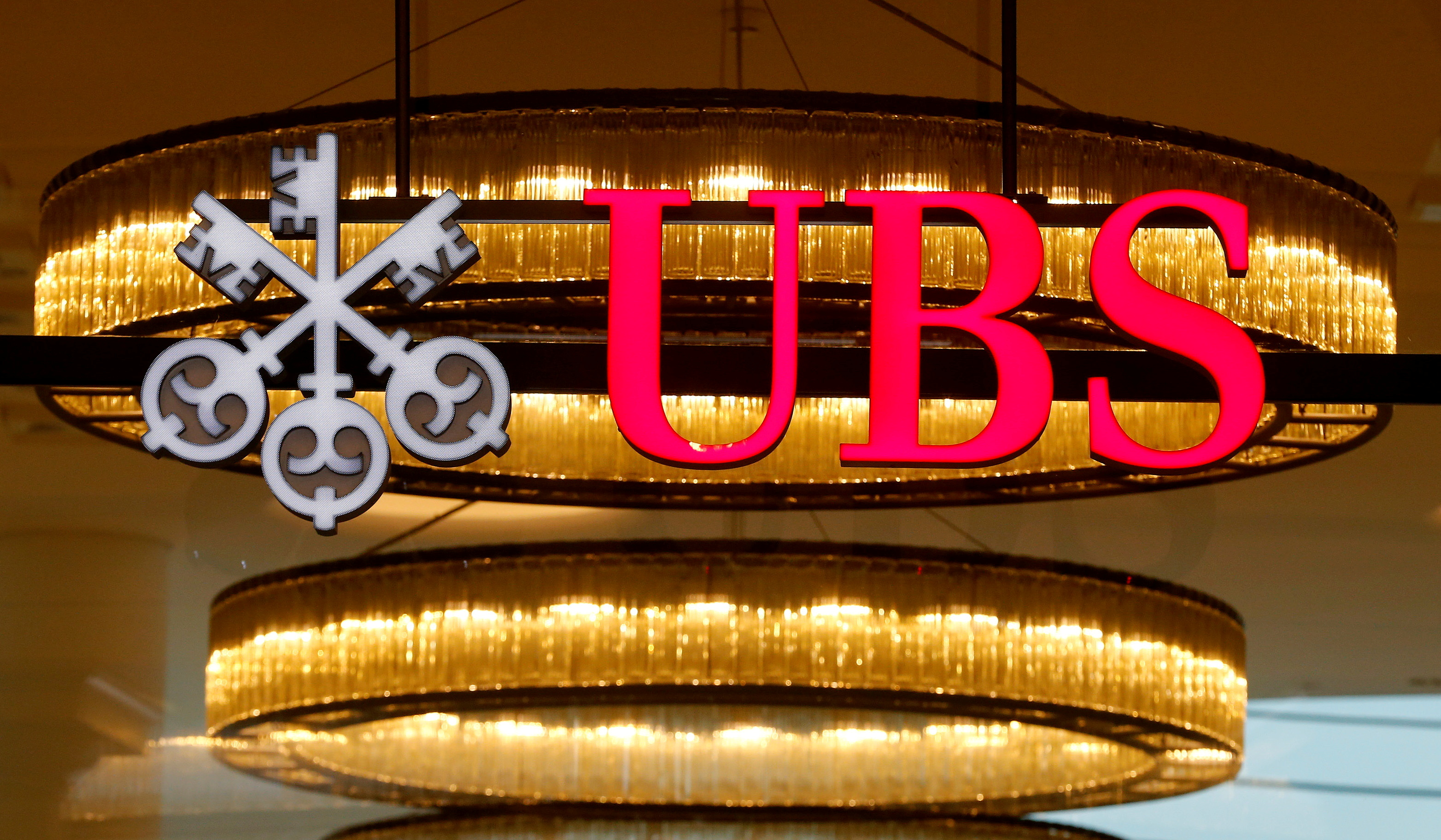 The logo of Swiss bank UBS is seen at a branch office in Basel, Switzerland, March 29, 2017.  REUTERS/Arnd Wiegmann/File Photo
