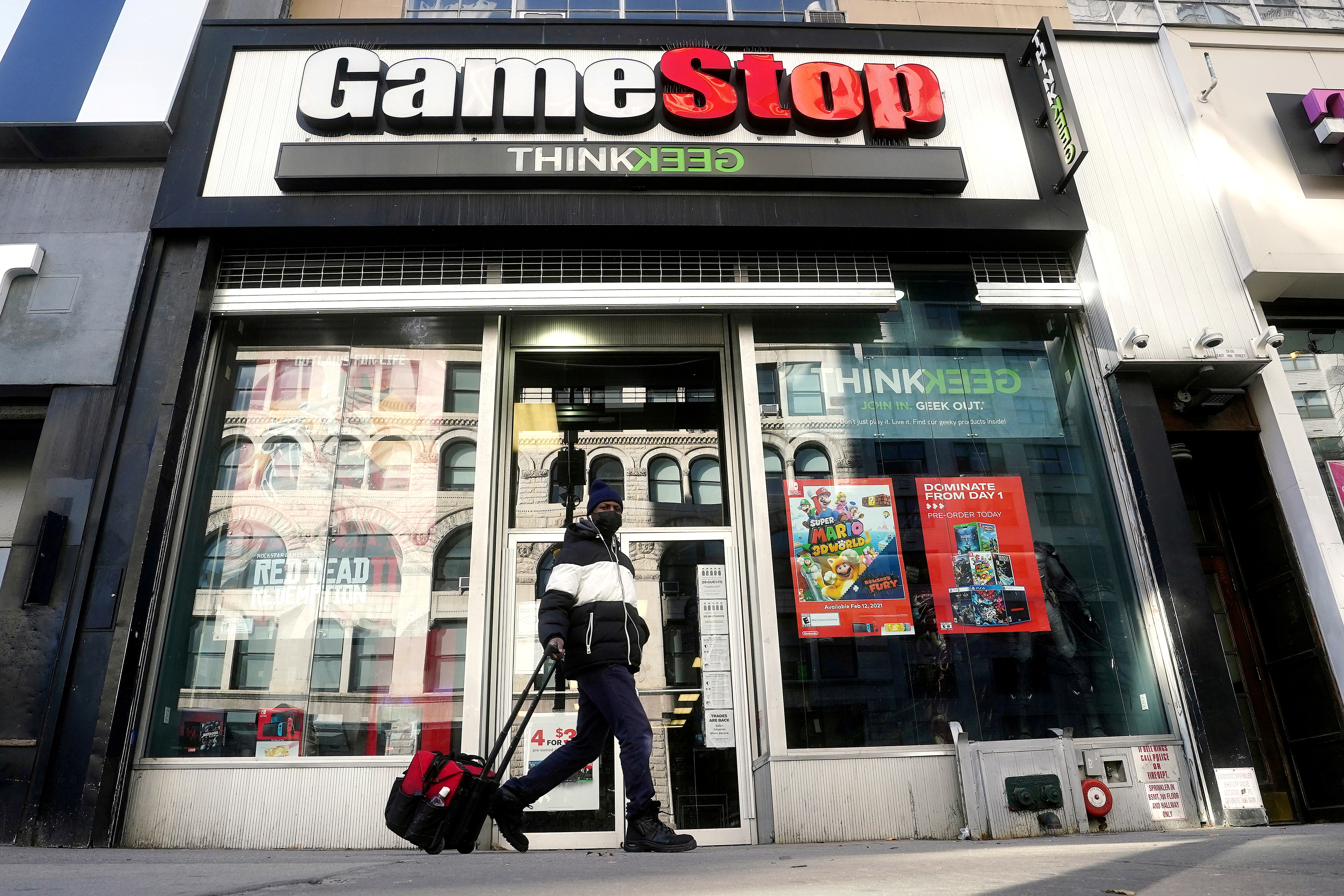 A person walks past a GameStop store in the Manhattan borough of New York City, New York, U.S., January 29, 2021. REUTERS/Carlo Allegri