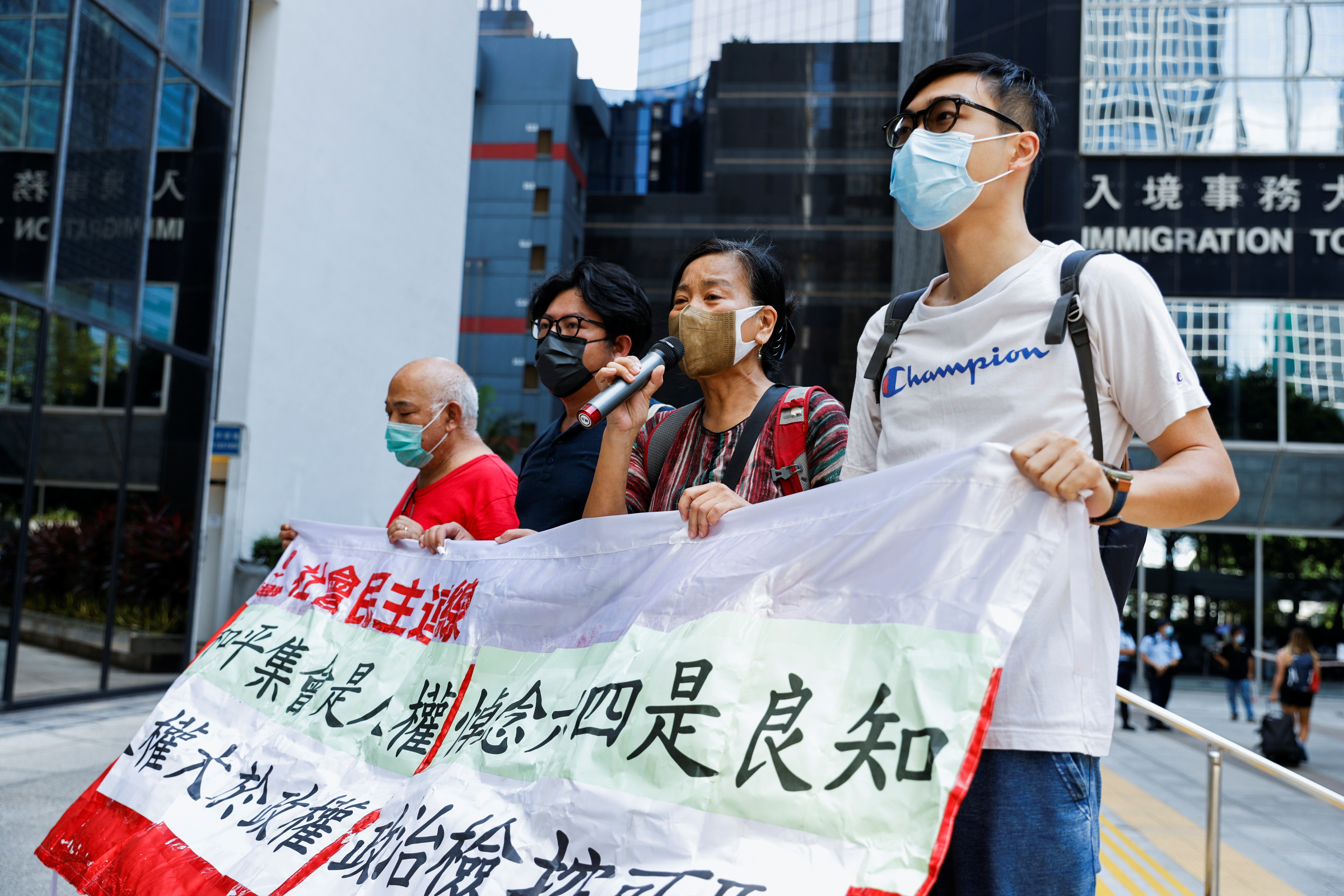 Pro-democracy activists shout slogans outside the court to support activists charged for participating in the assembly on June 4 to commemorate the 1989 crackdown on protesters in and around Beijing's Tiananmen Square, in Hong Kong, China, September 15, 2021. REUTERS/Tyrone Siu