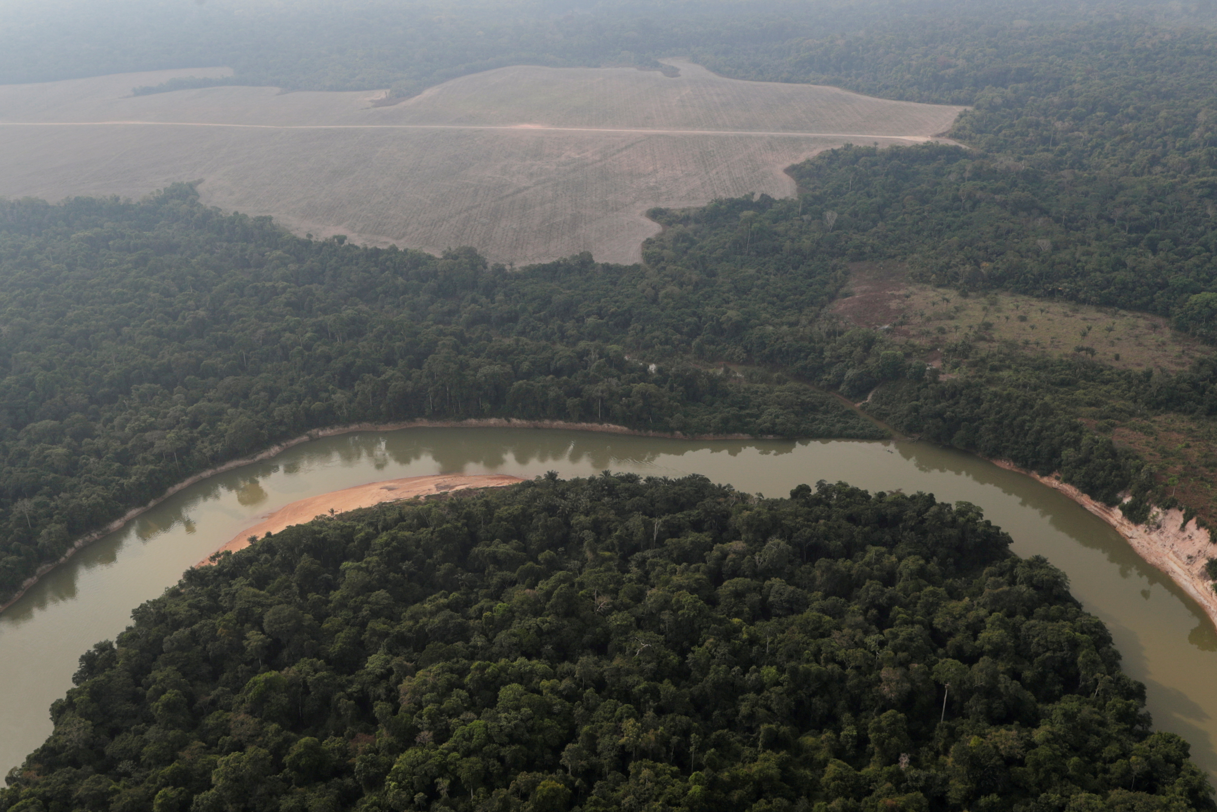 n aerial view shows a river and a deforested plot of the Amazon near Porto Velho, Rondonia State, Brazil August 14, 2020. REUTERS/Ueslei Marcelino/File Photo