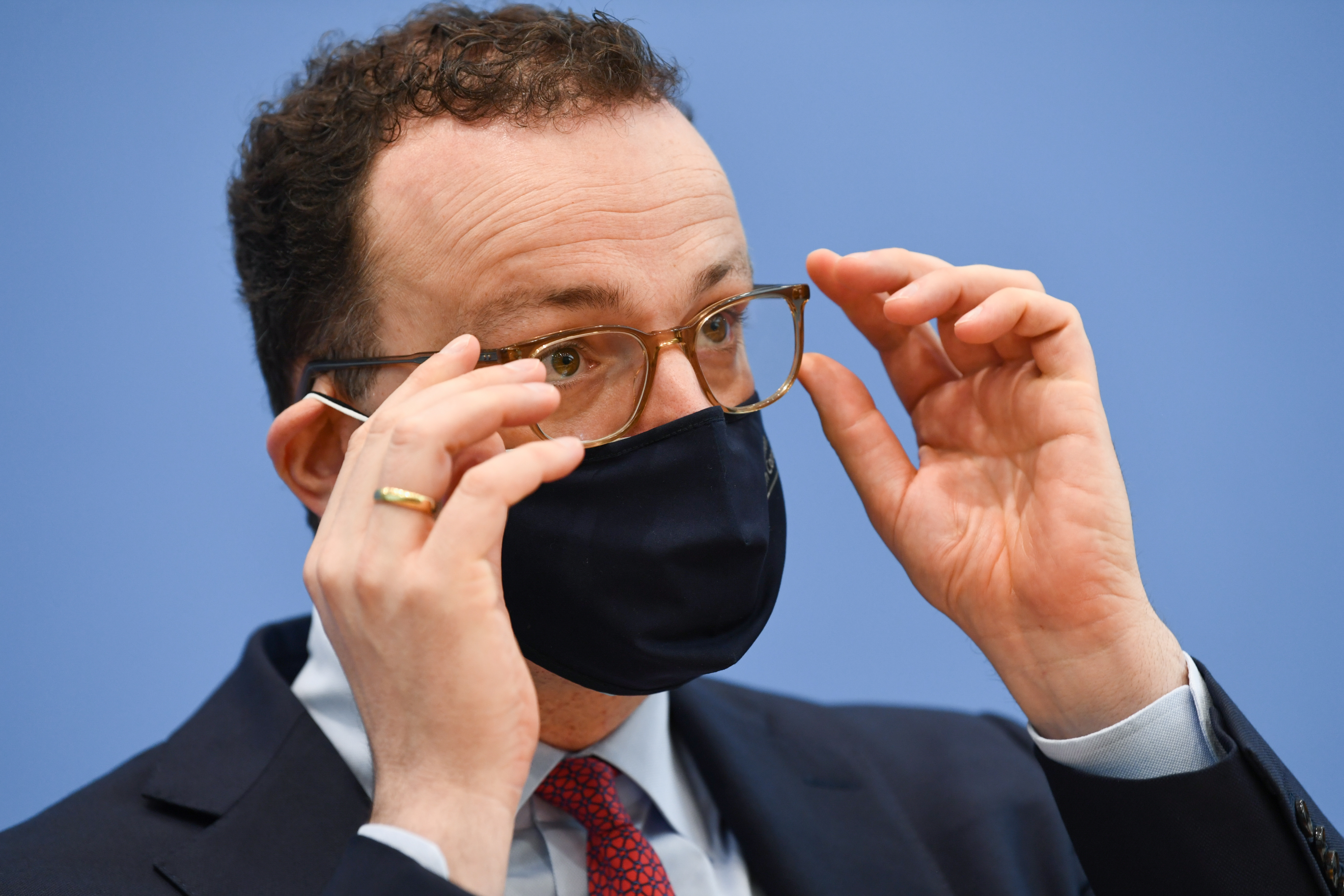 German Health Minister Jens Spahn adjusts his glasses during a news conference regarding the start of the coronavirus disease (COVID-19) vaccination process at general practices, in Berlin, Germany, April 1, 2021.  REUTERS/Annegret Hilse/Pool