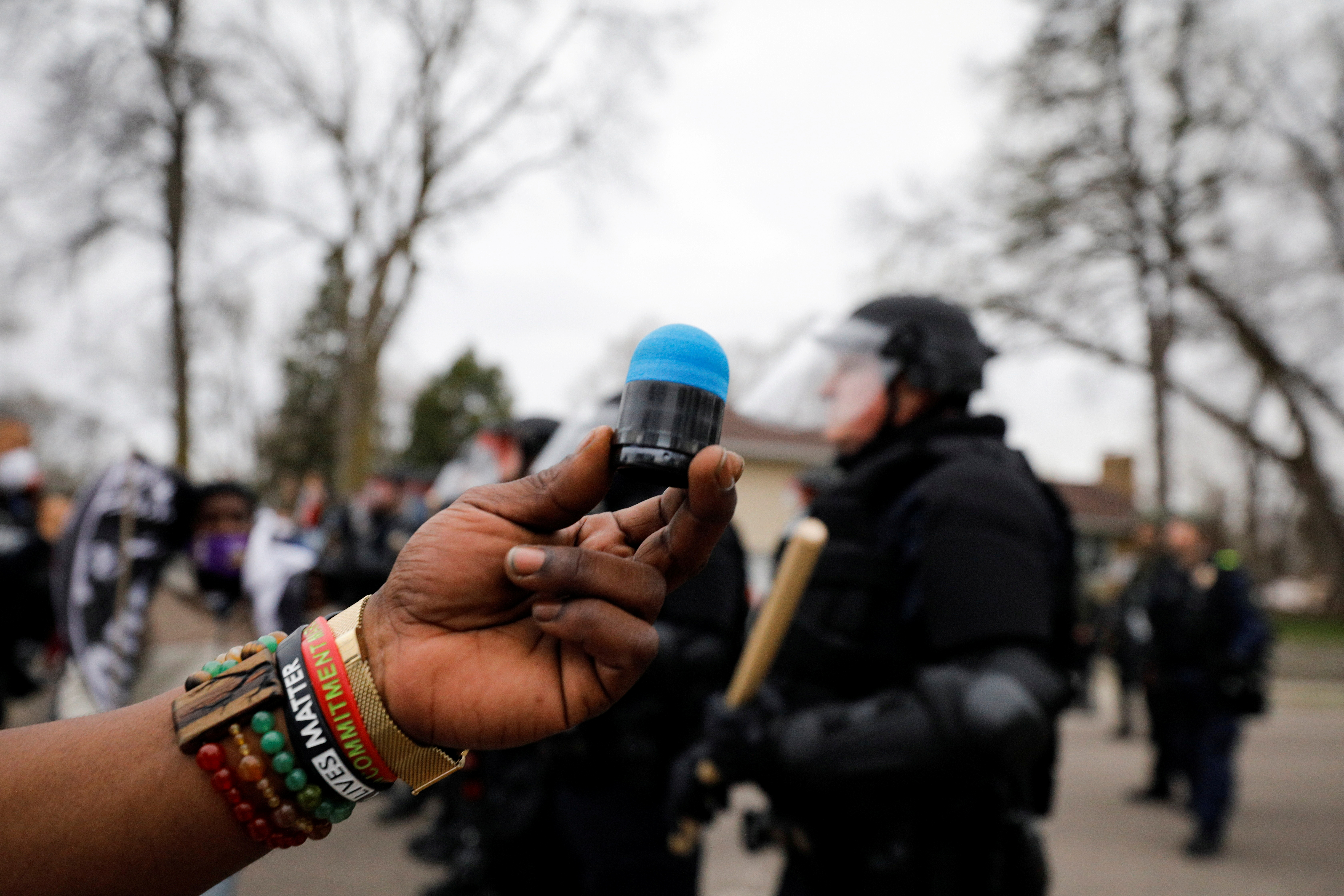 Cortez Rice holds up the rubber bullet that hit him in his side during a confrontation with police after police allegedly shot and killed a man, who local media report is identified by the victim's mother as Daunte Wright, in Brooklyn Center, Minnesota, U.S., April 11, 2021. REUTERS/Nick Pfosi