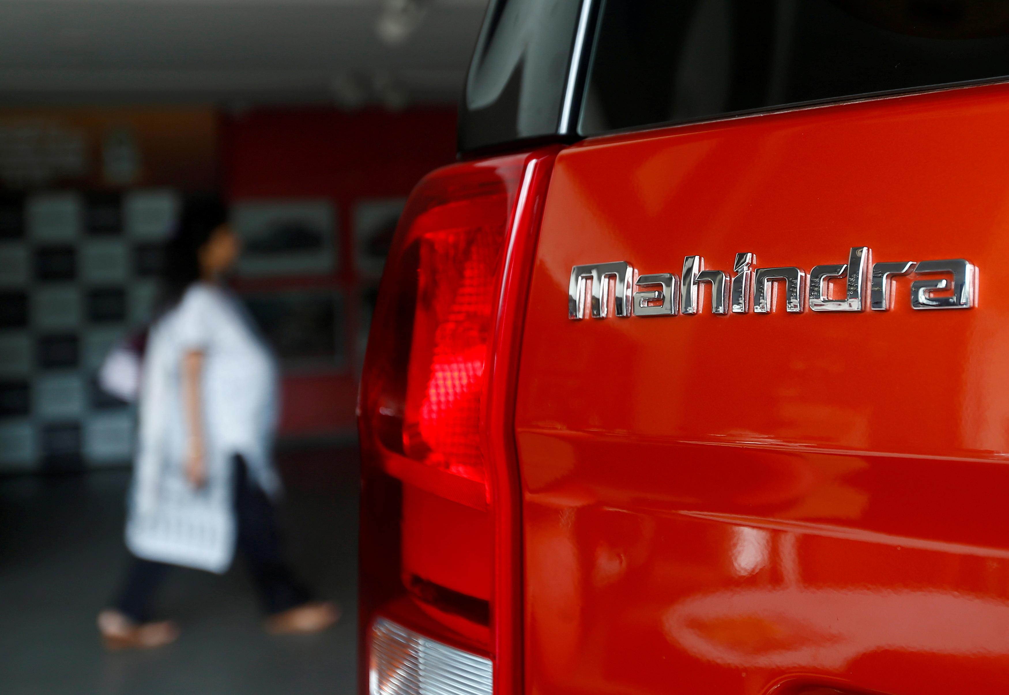 An employee walks past a Mahindra TUV300 car at a showroom in Mumbai, India, August 30, 2016. Picture taken August 30, 2016. REUTERS/Danish Siddiqui/File Photo