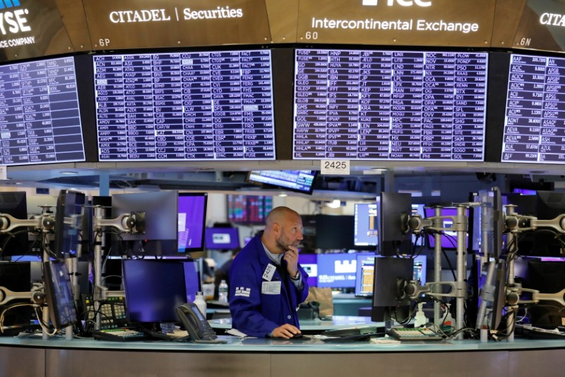 A trader works on the trading floor at the New York Stock Exchange (NYSE) in Manhattan, New York City, U.S., August 9, 2021. REUTERS/Andrew Kelly