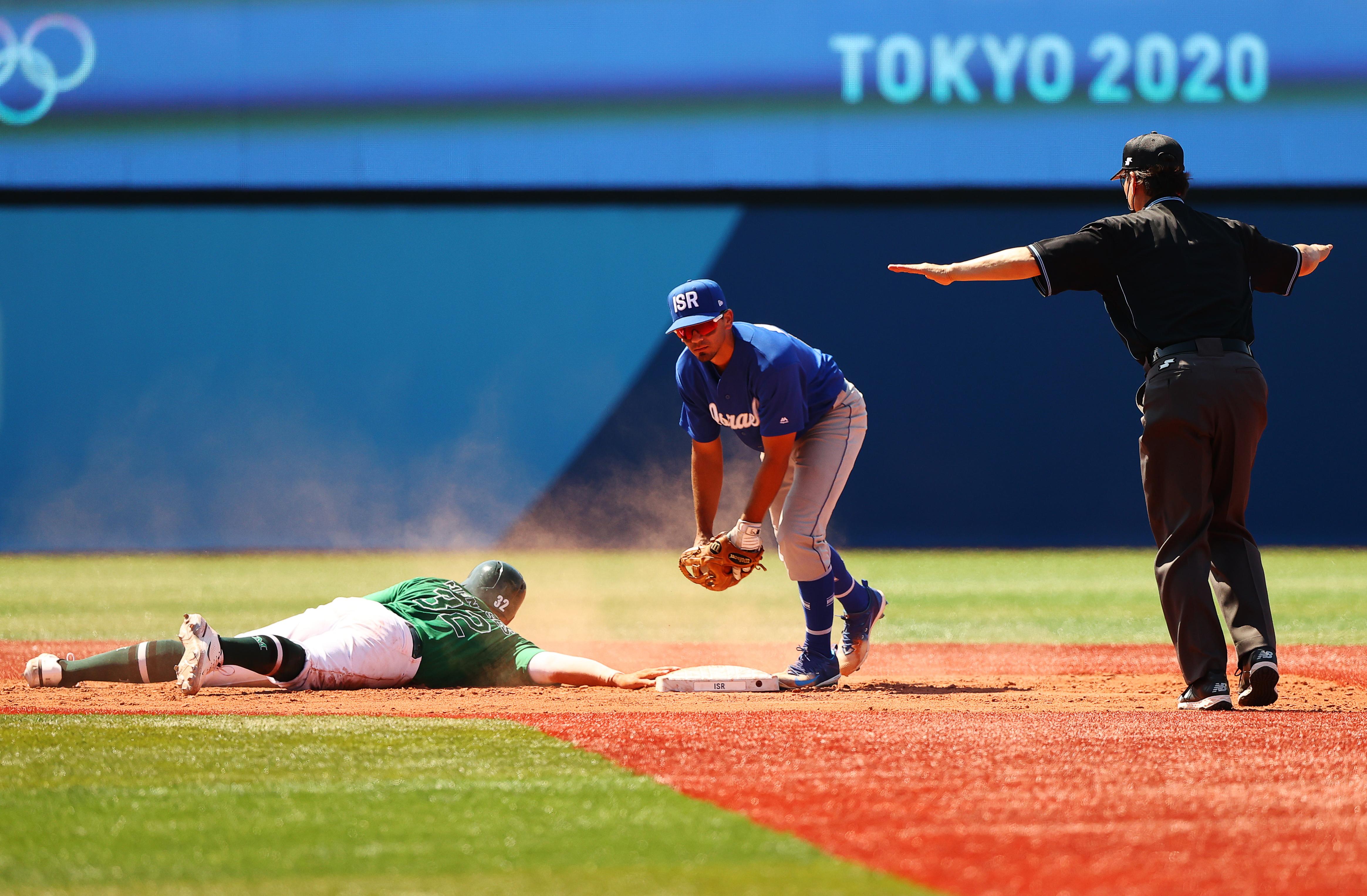Tokyo 2020 Olympics - Baseball - Men - Knockout Round 1 - Israel v Mexico - Yokohama Baseball Stadium, Yokohama, Japan - August 1, 2021. Joey Meneses of Mexico safe at base, next to Scott Burcham of Israel. REUTERS/Jorge Silva