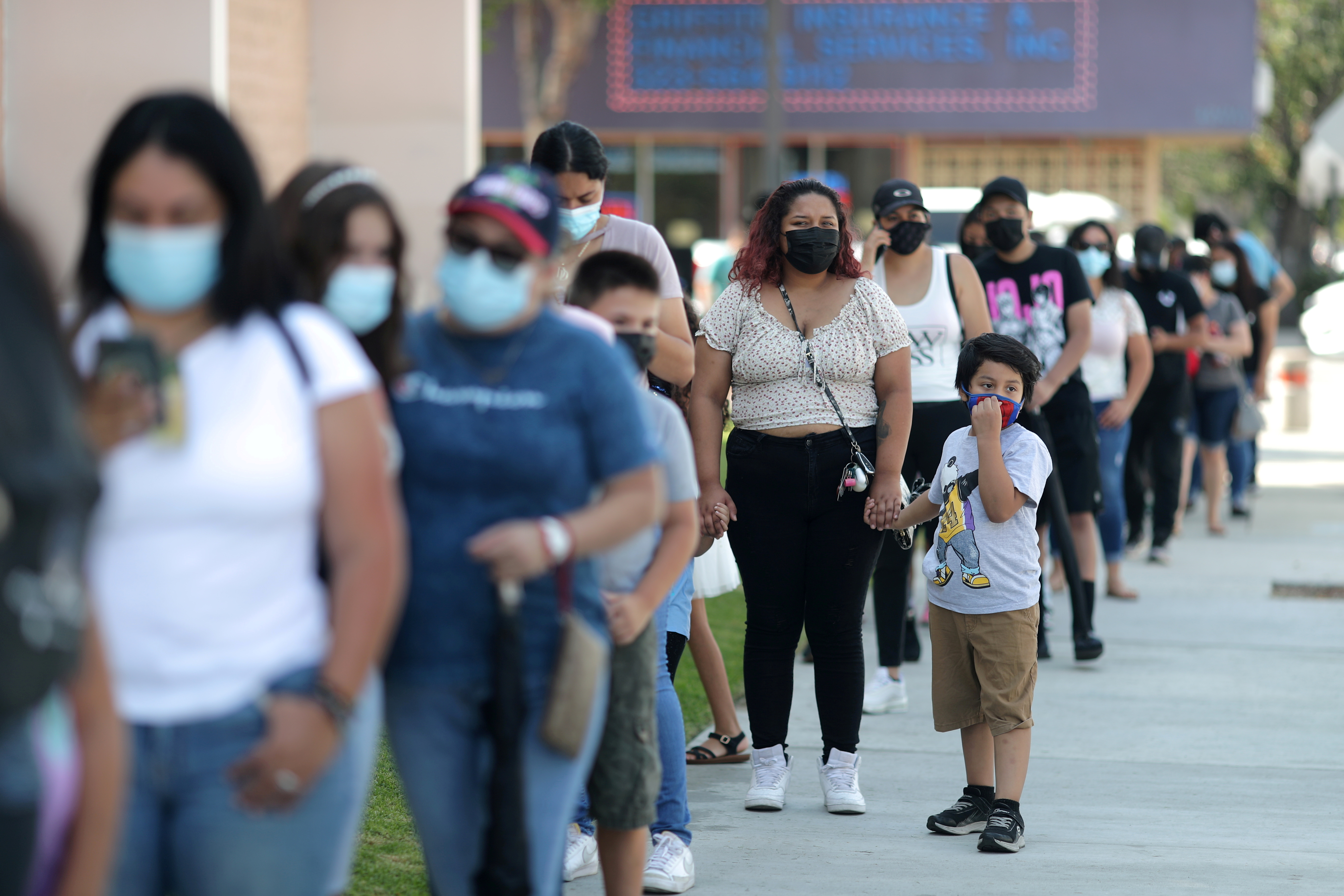 People wait in line for a coronavirus disease (COVID-19) test at a back-to-school clinic in South Gate, Los Angeles, California, U.S., August 12, 2021. REUTERS/Lucy Nicholson/File Photo