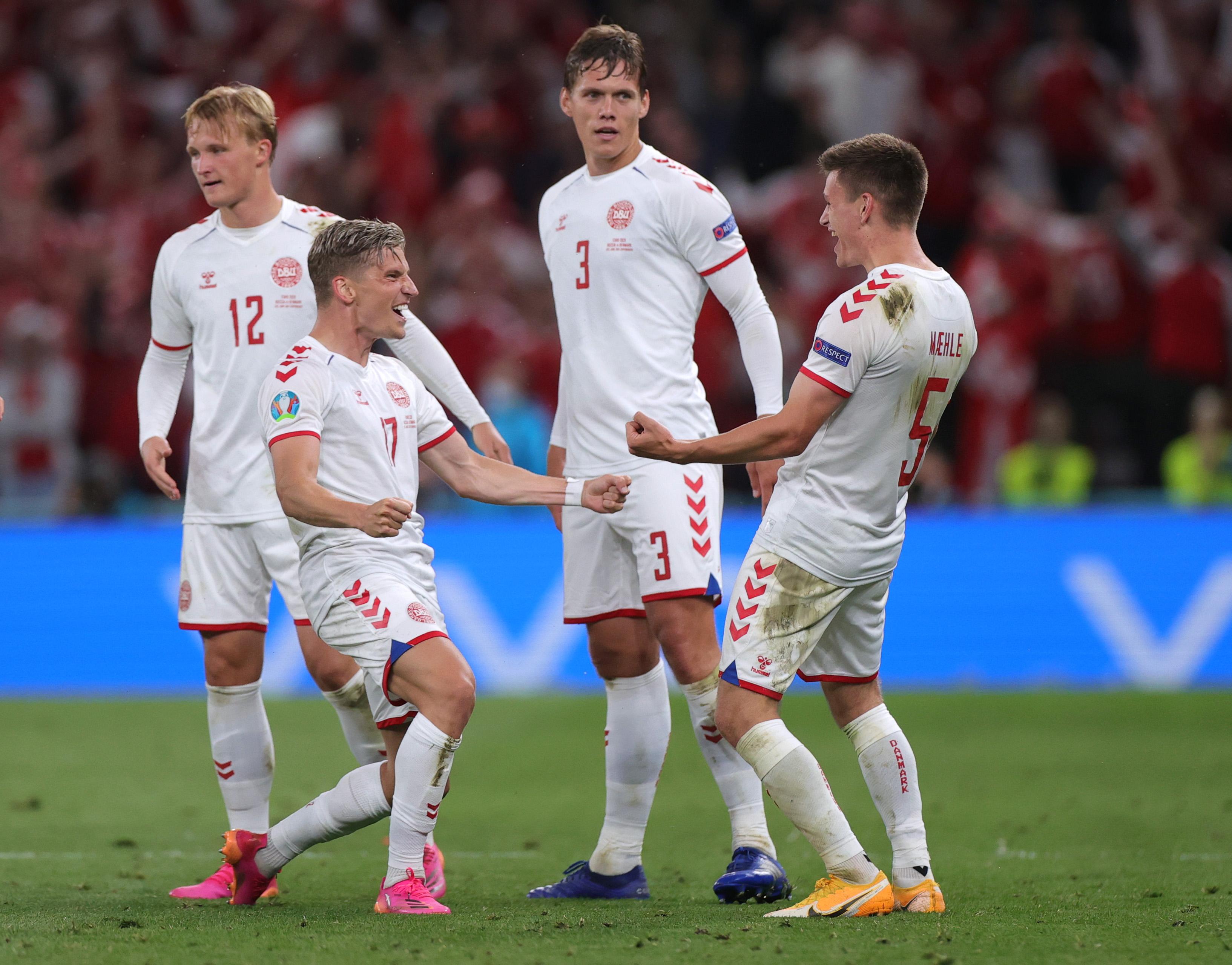 Soccer Football - Euro 2020 - Group B - Russia v Denmark - Parken Stadium, Copenhagen, Denmark - June 21, 2021  Denmark's Joakim Maehle celebrates scoring their fourth goal with teammates Pool via REUTERS/Friedemann Vogel