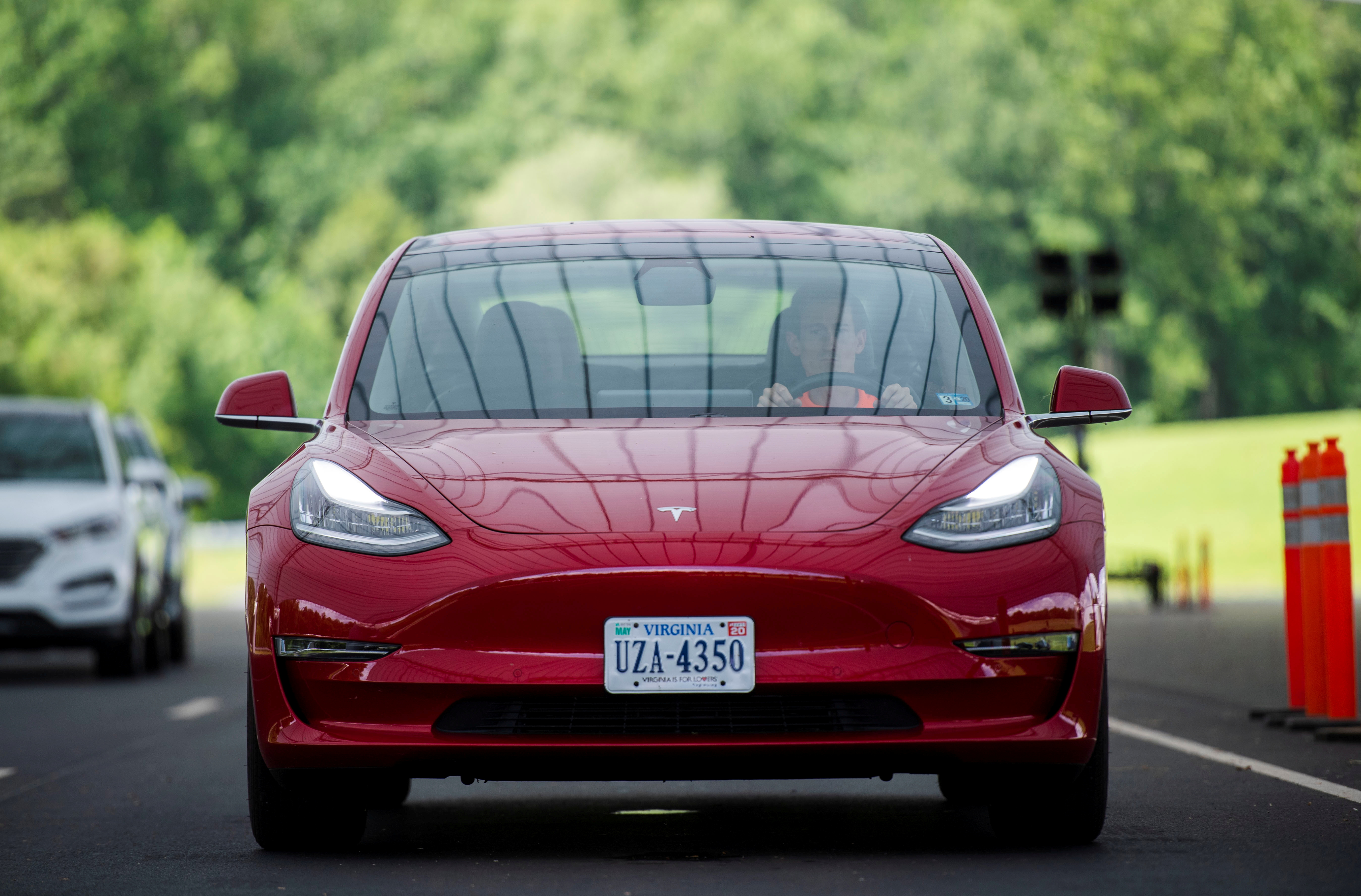 Joe Young, a media relations associate for the Insurance Institute for Highway Safety (IIHS), demonstrates a front crash prevention test on a 2018 Tesla Model 3 at the IIHS-HLDI Vehicle Research Center in Ruckersville, Virginia, U.S., July 22, 2019. REUTERS/Amanda Voisard/File Photo
