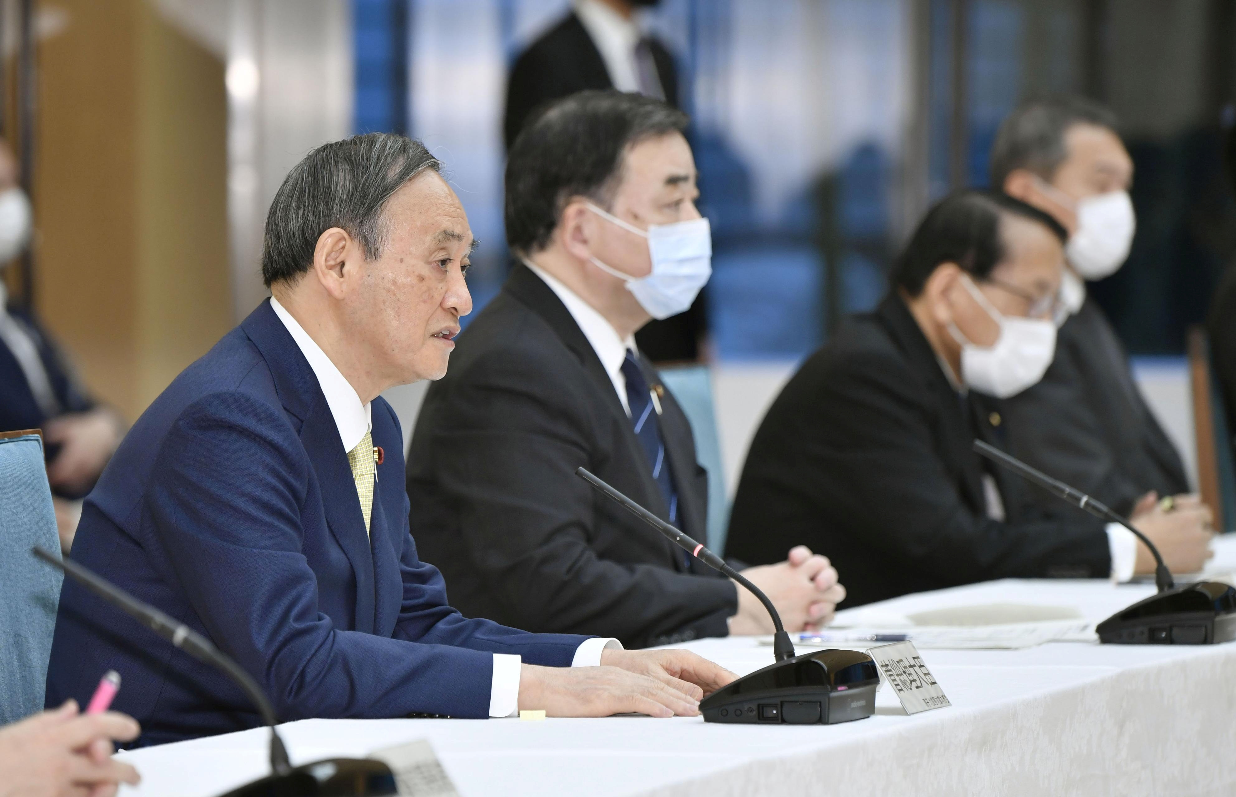 Japan's Prime Minister Yoshihide Suga attends a cabinet meeting at his official residence in Tokyo, Japan April 13, 2021, in this photo taken by Kyodo. Kyodo/via REUTERS