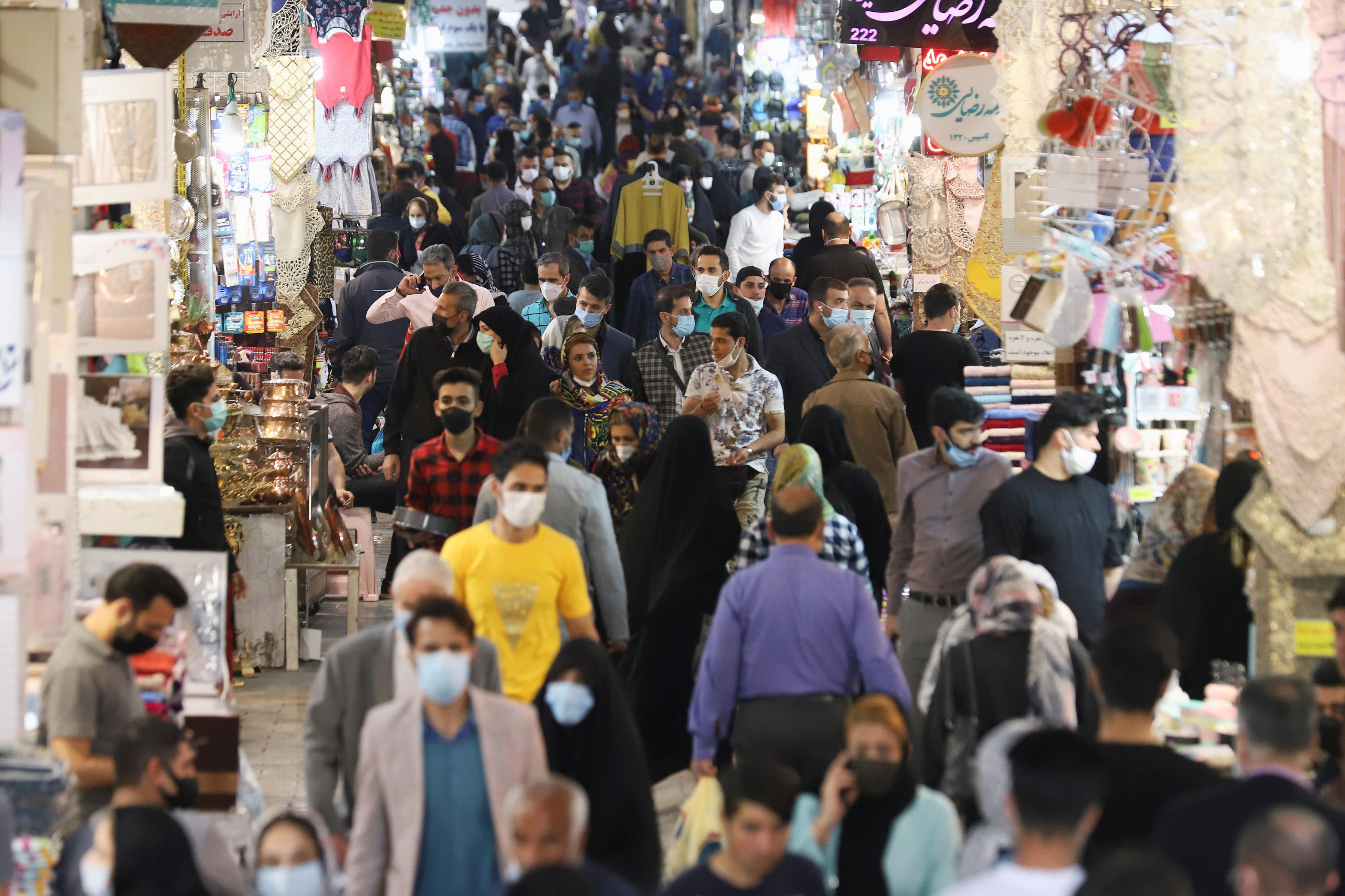 Iranian people walk in Tehran Bazaar, in Tehran, Iran April 6, 2021. Majid Asgaripour/WANA (West Asia News Agency) via REUTERS