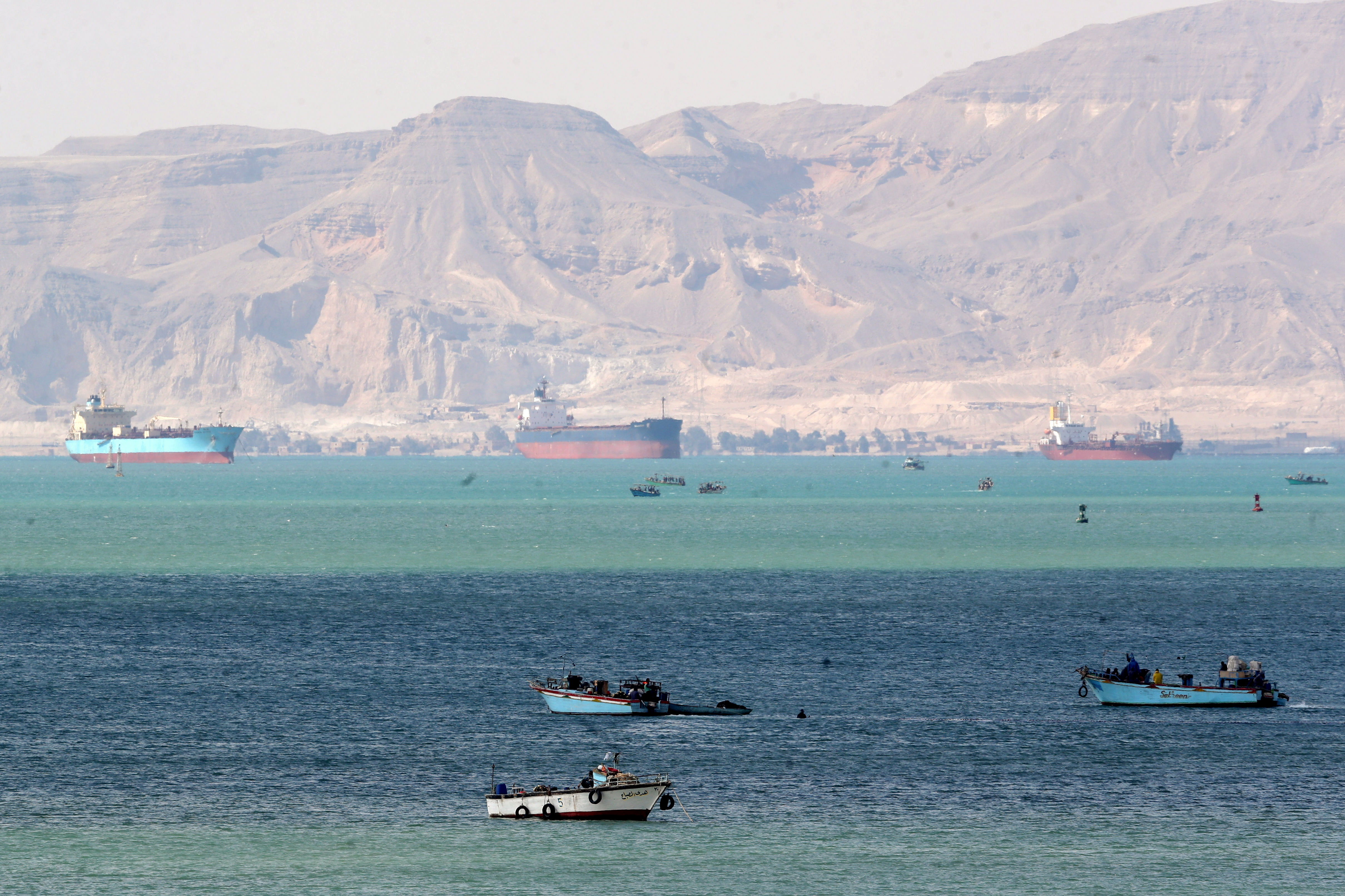 Ships and boats are seen at the entrance of Suez Canal, which was blocked by stranded container ship Ever Given that ran aground, Egypt March 28, 2021. REUTERS/Mohamed Abd El Ghany