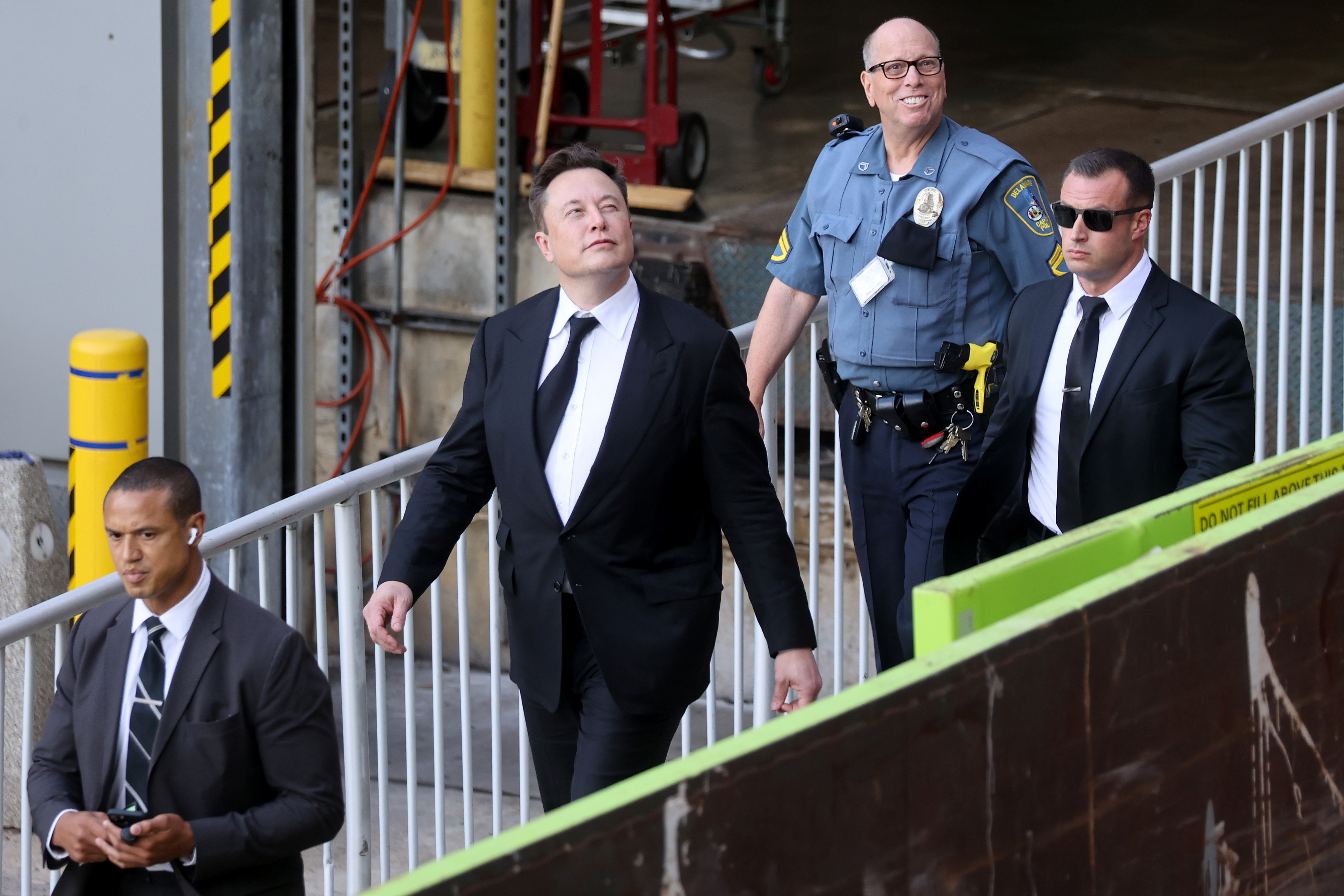 Tesla CEO Elon Musk reacts to onlookers as he departs after taking the stand to defend Tesla Inc's 2016 deal for SolarCity in a case before the Delaware Court of Chancery in Wilmington, Delaware, U.S. July 12, 2021. REUTERS/Jonathan Ernst