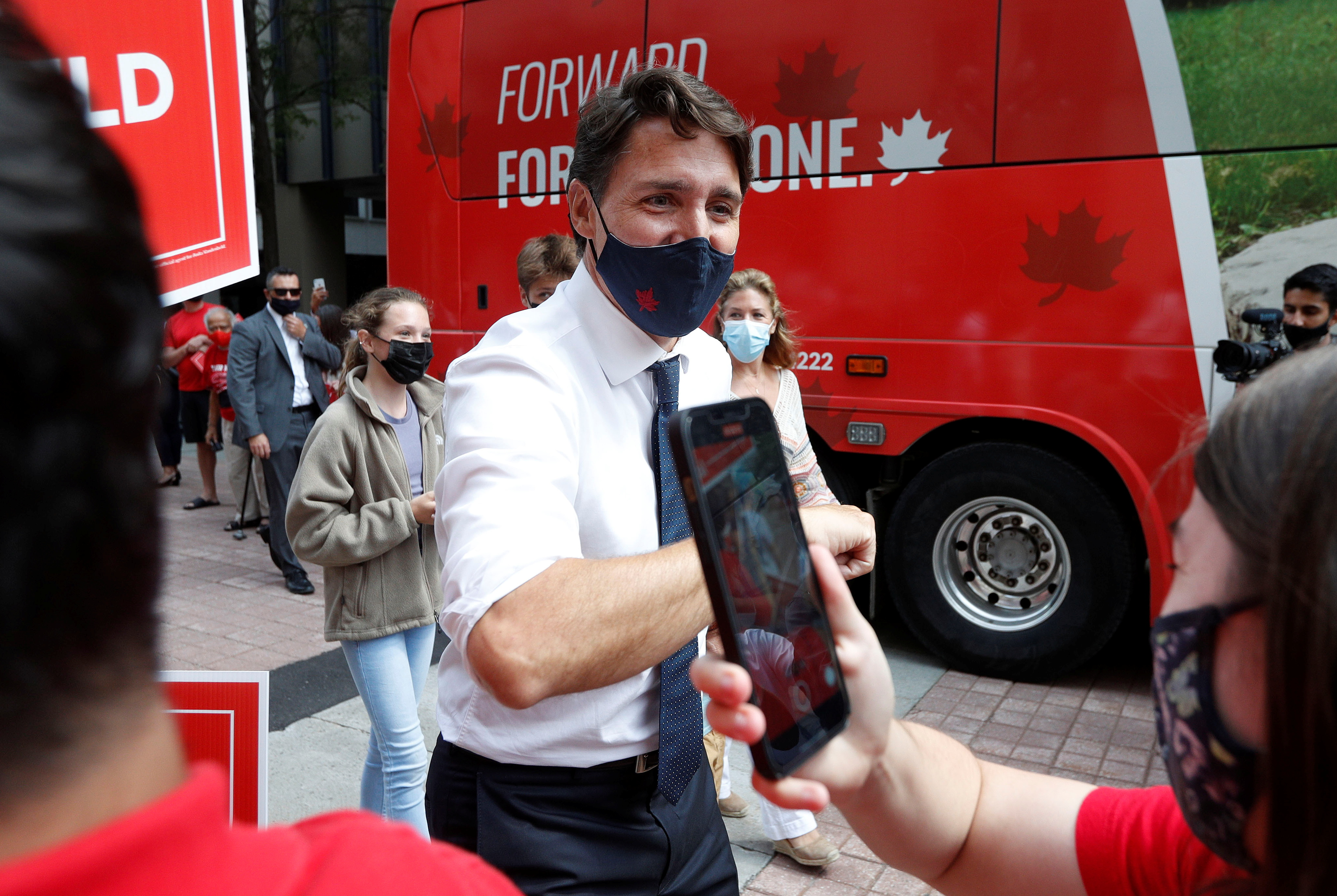 Canada's Liberal Prime Minister Justin Trudeau greets supporters as he arrives at the Marriott hotel before embarking on his first election campaign visit, in Ottawa, Ontario, Canada August 15, 2021. REUTERS/Lars Hagberg