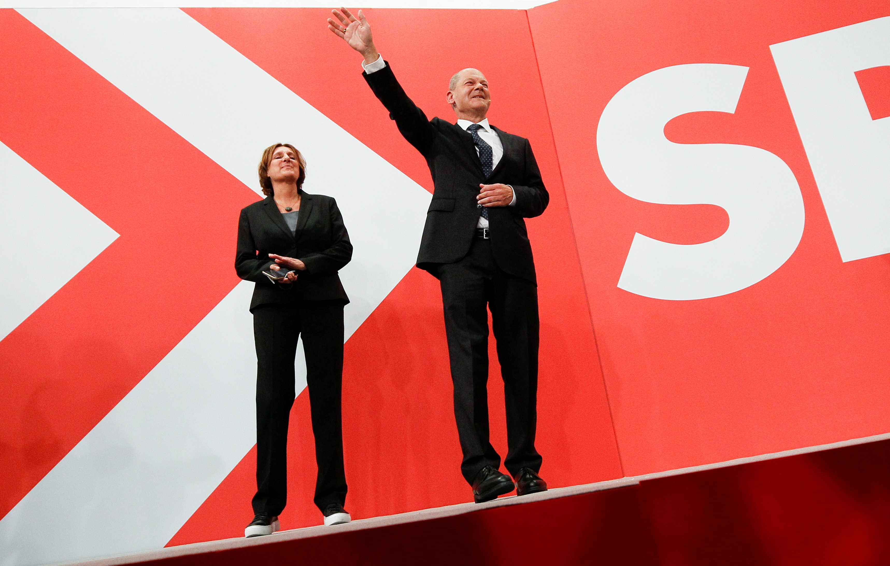 Social Democratic Party (SPD) leader and top candidate for chancellor Olaf Scholz and his wife Britta Ernst react after first exit polls for the general elections in Berlin, Germany, September 26, 2021.  REUTERS/Wolfgang Rattay