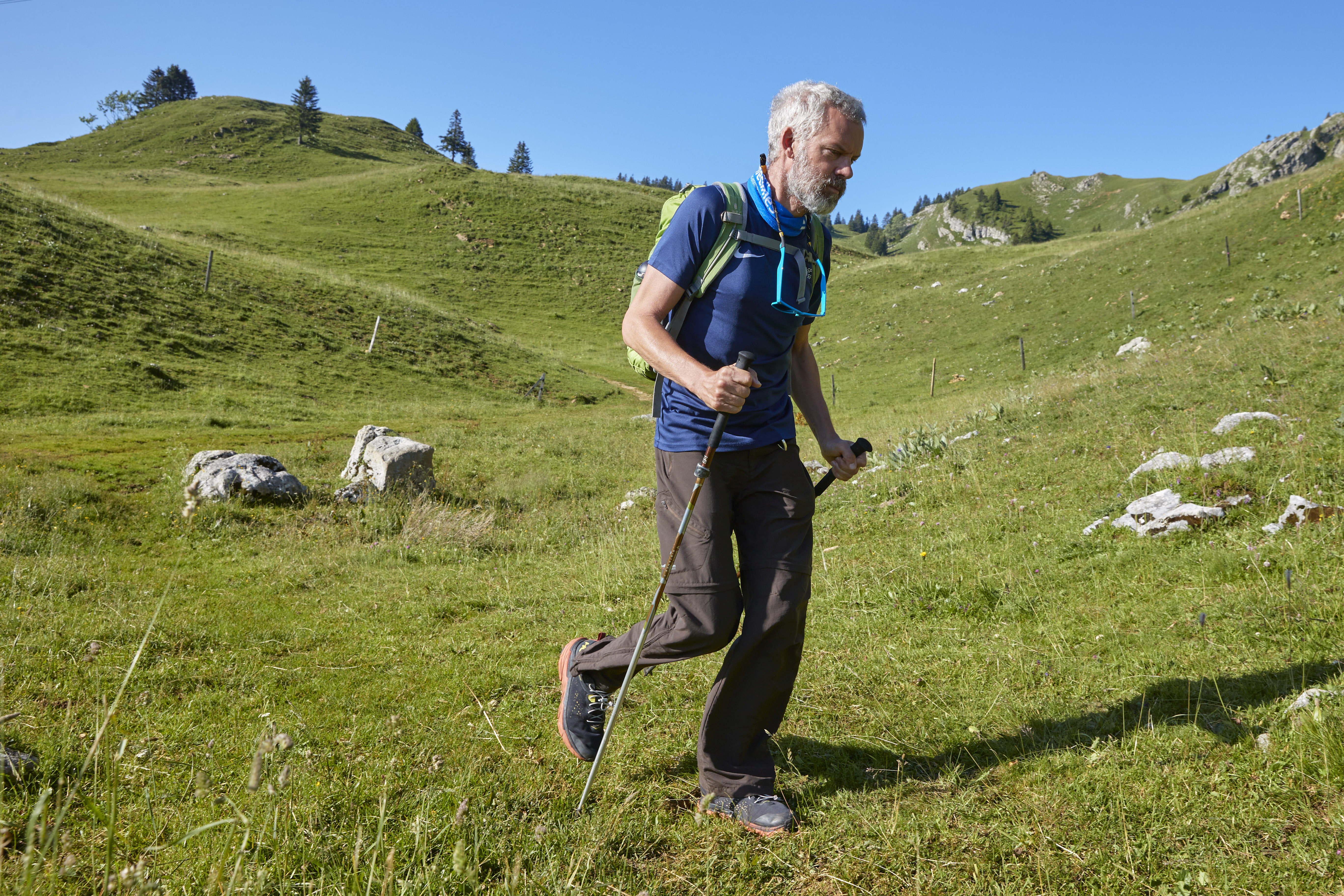 Yves Auberson, who has Parkinson disease and recently walked 1122 kilometres through the Alps, poses in a pasture at La Dole in Cheserex near Geneva, Switzerland, July 19, 2021. REUTERS/Denis Balibouse