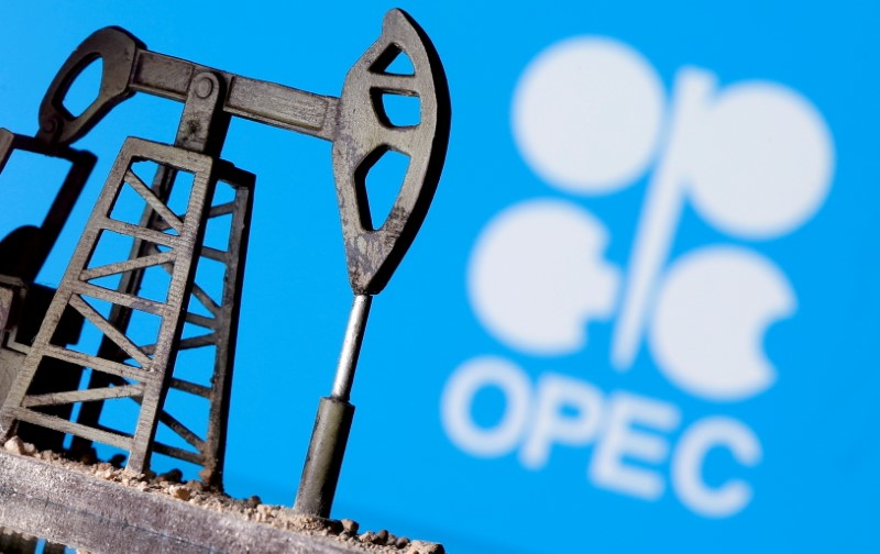 A 3D-printed oil pump jack is seen in front of displayed OPEC logo in this illustration picture, April 14, 2020. REUTERS/Dado Ruvic/File Photo