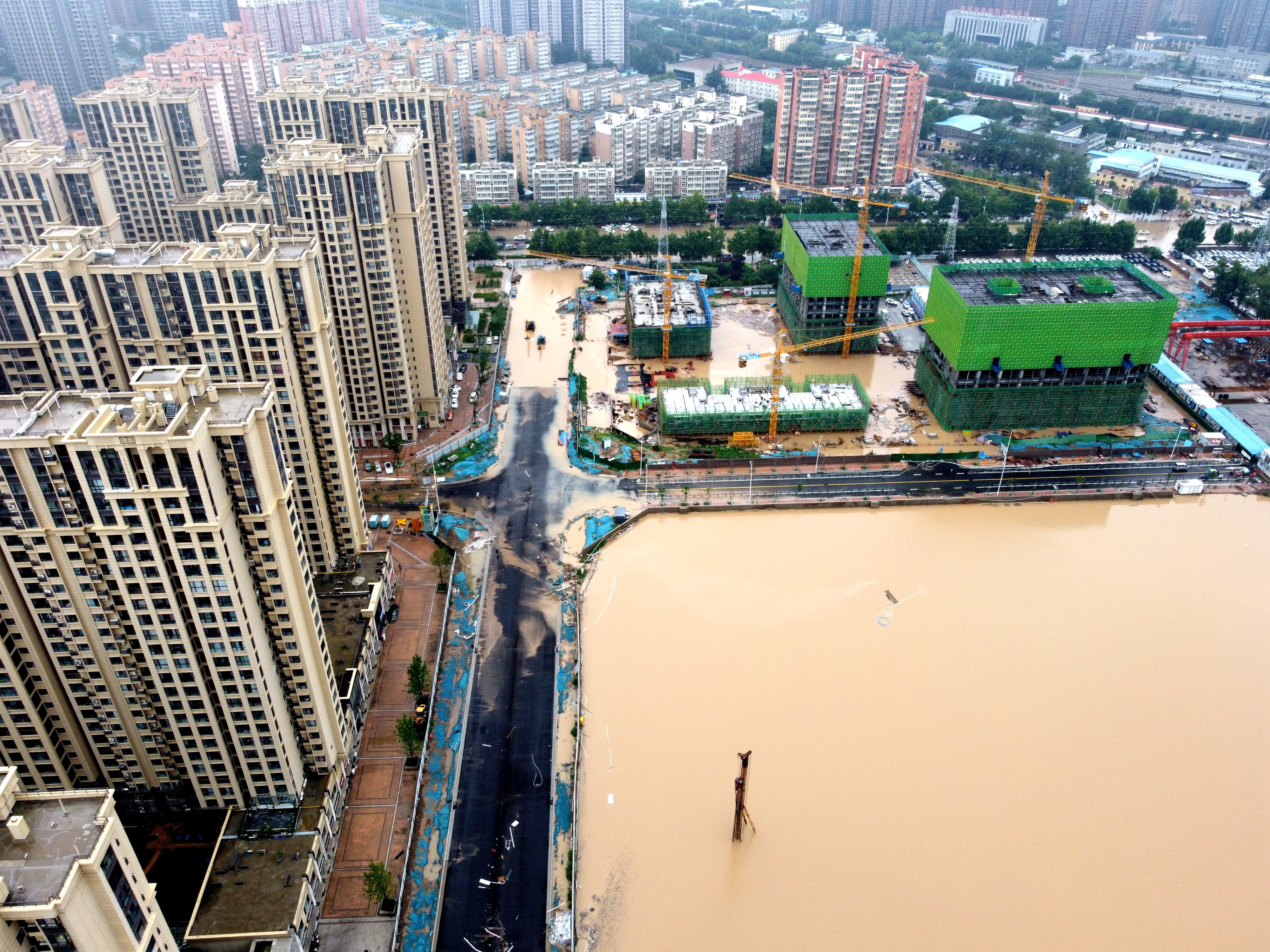 An aerial view shows the flooded areas following heavy rainfall in Zhengzhou, Henan province, China July 21, 2021. cnsphoto via REUTERS