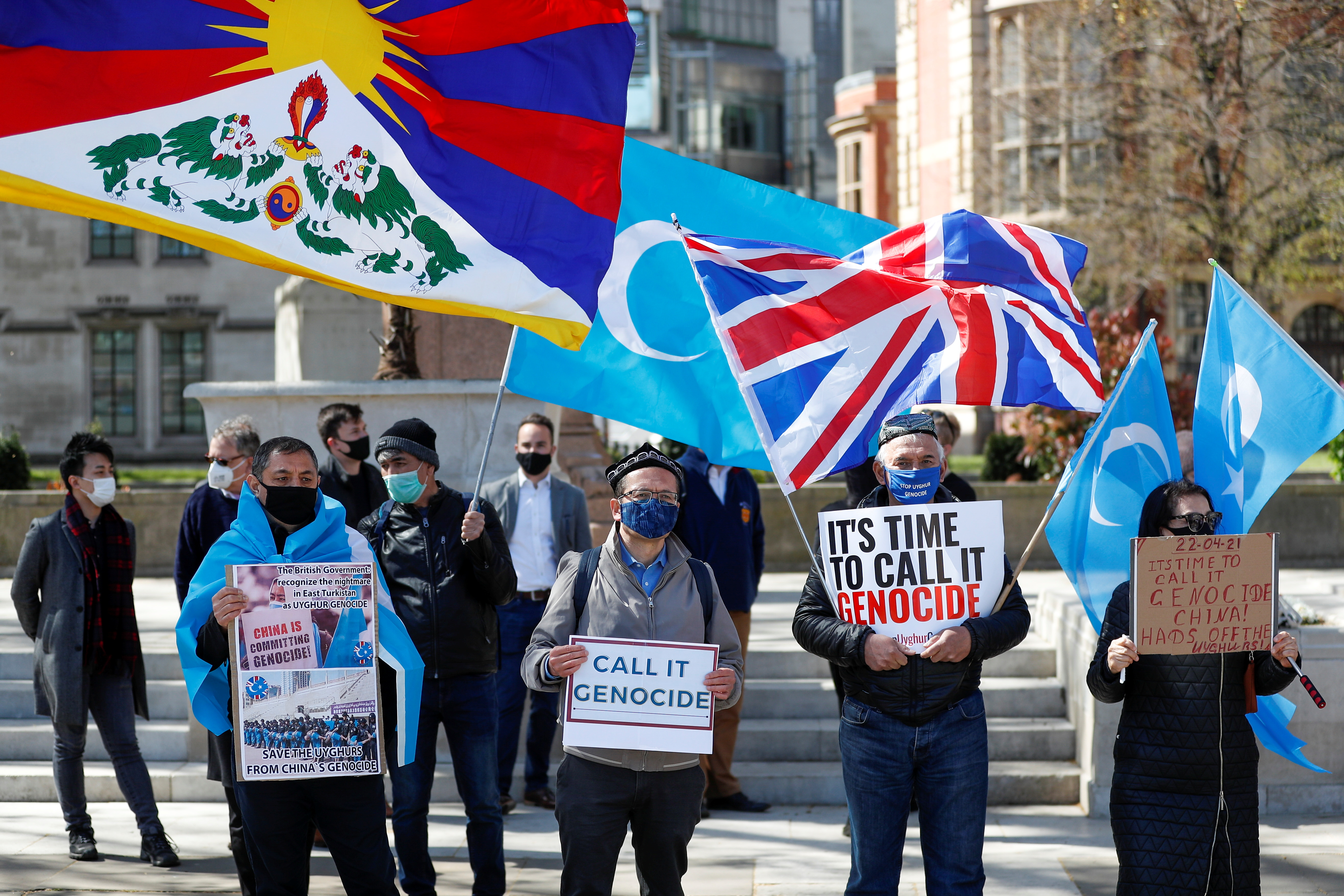 Demonstrators hold placards during a protest against Uyghur genocide, in London, Britain April 22, 2021. REUTERS/Peter Nicholls
