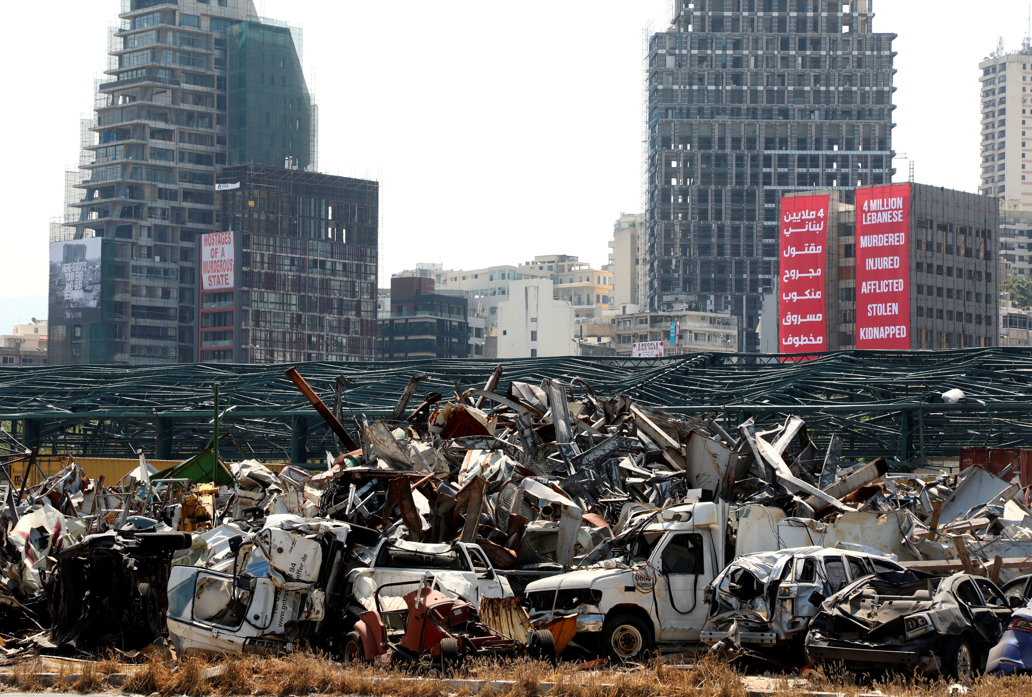 A view shows damaged cars from last year's Beirut port blast as Lebanon marks the one-year anniversary of Beirut port explosion, inside Beirut port, Lebanon August 4, 2021. REUTERS/Mohamed Azakir