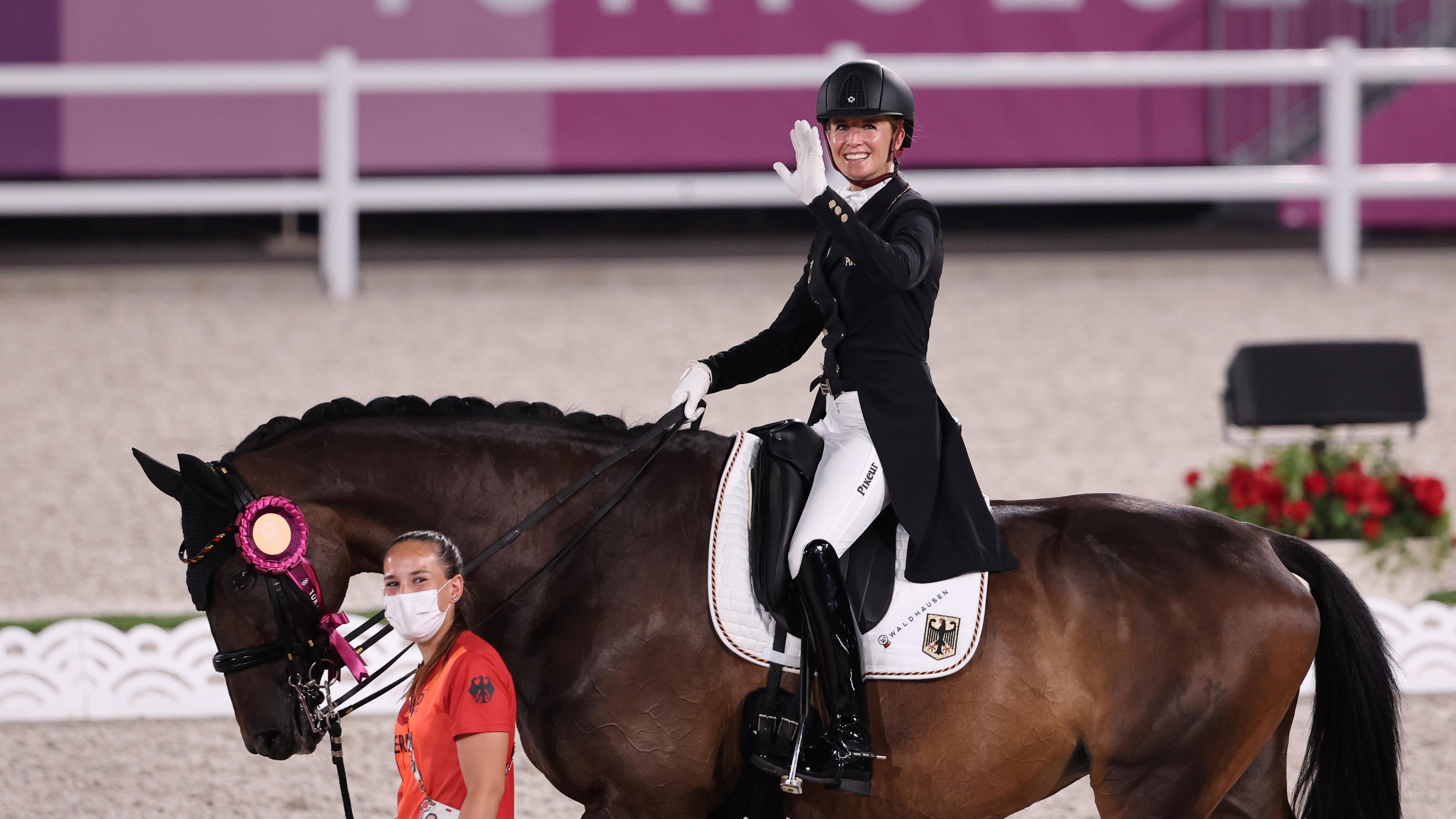 Tokyo 2020 Olympics - Equestrian - Dressage - Team - Medal Ceremony - Equestrian Park - Tokyo, Japan - July 27, 2021. Jessica von Bredow-Werndl of Germany on her horse Dalera after winning the gold medal REUTERS/Alkis Konstantinidis