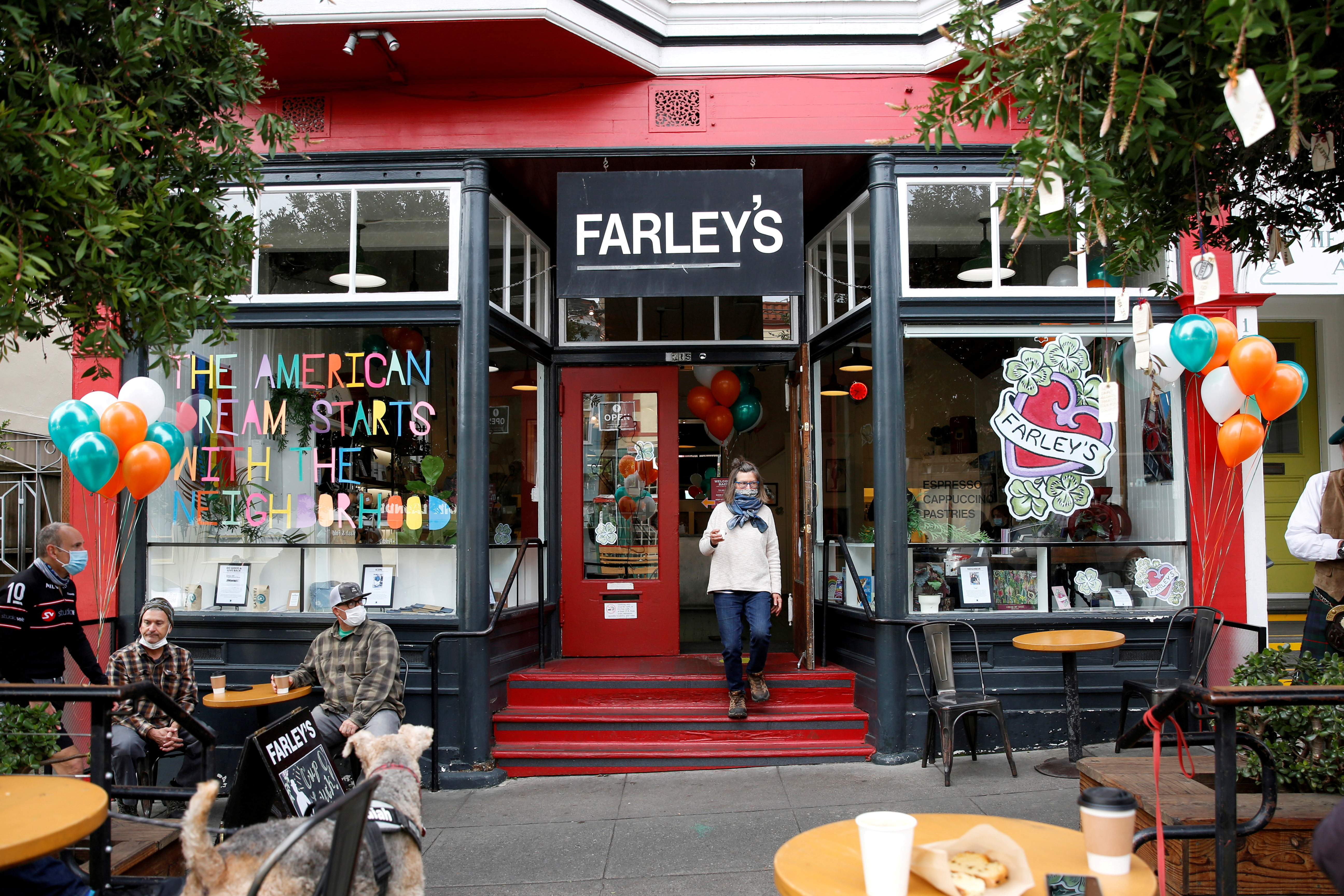 Guests enjoy live music and coffee outside as Farley's cafe marks its 32nd anniversary with bagpipes, Irish stew, and live music on St. Patrick's Day in San Francisco, California, U.S. March 17, 2021. REUTERS/Brittany Hosea-Small/File Photo
