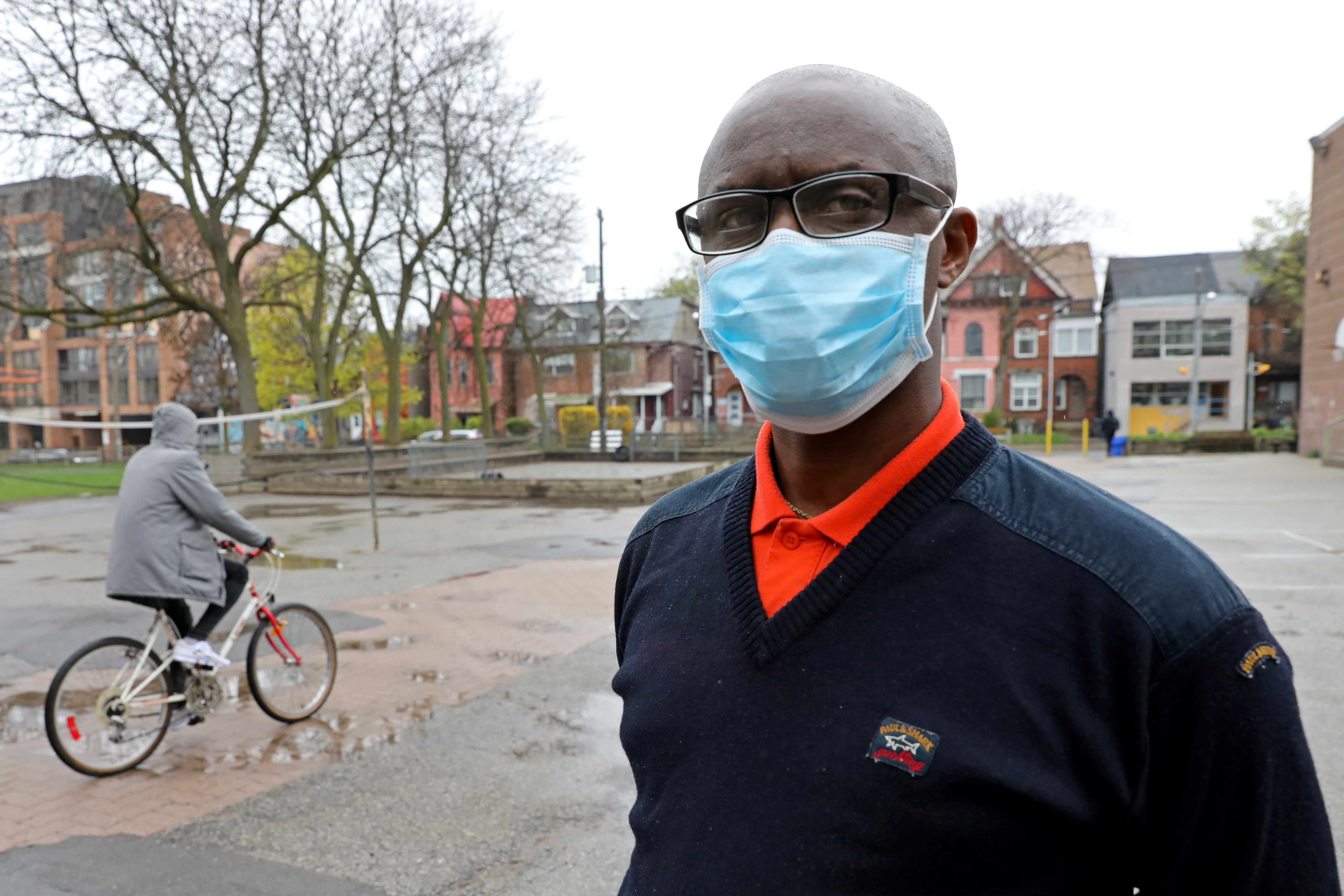 Apollinaire Nduwimana, a Burundian teacher and asylum-seeker who is awaiting a refugee application, poses outside a school near his lodging in Toronto, Ontario, Canada April 29, 2021. REUTERS/Chris Helgren