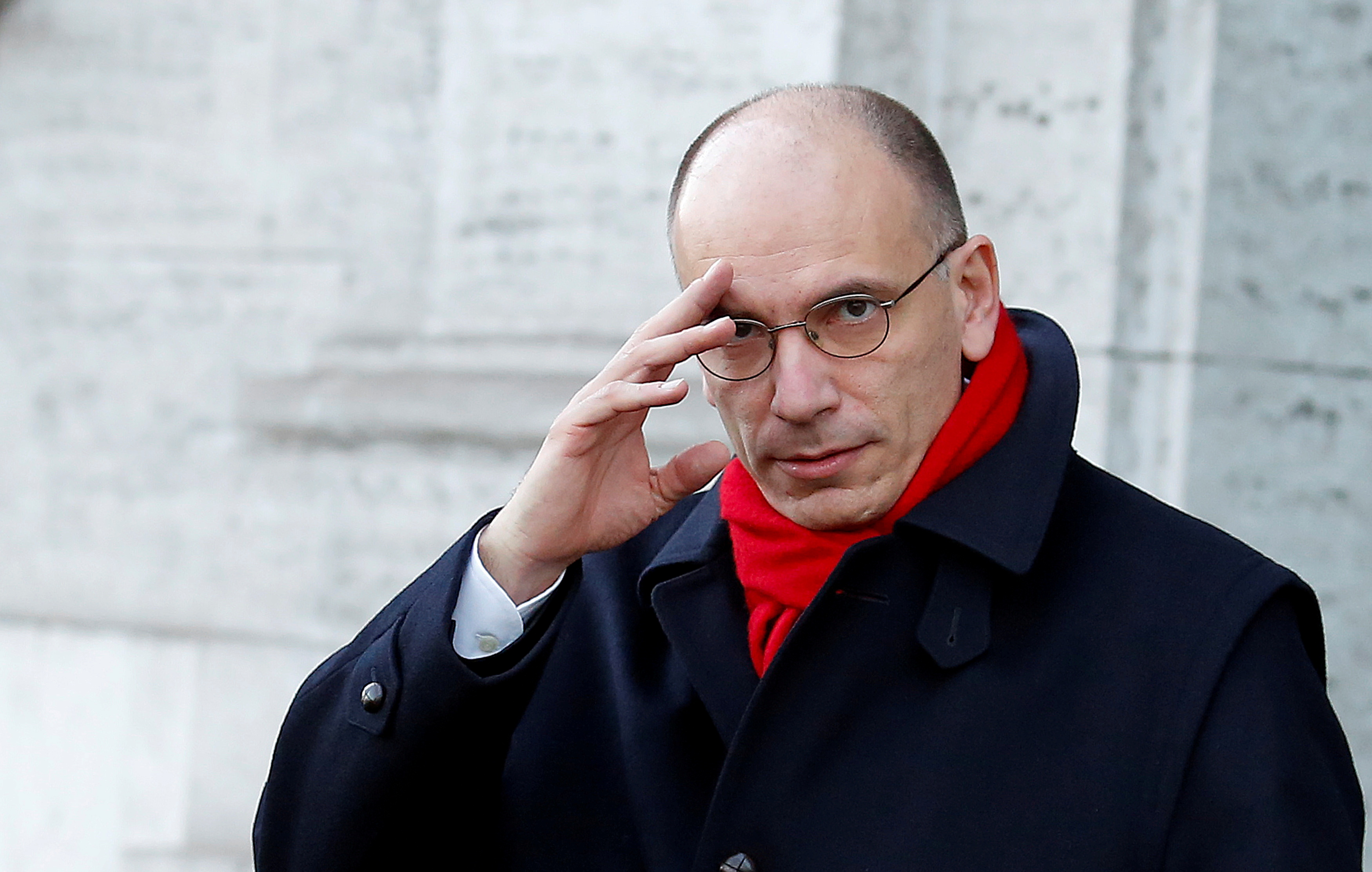 Italy's Prime Minister Enrico Letta gestures as he leaves his house in downtown Rome February 14, 2014.  REUTERS/Remo Casilli